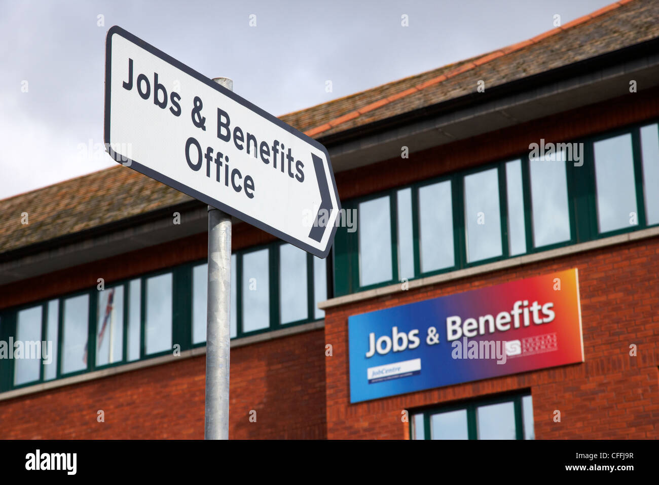 road sign pointing to jobs and benefits office antrim county antrim northern ireland uk - Stock Image