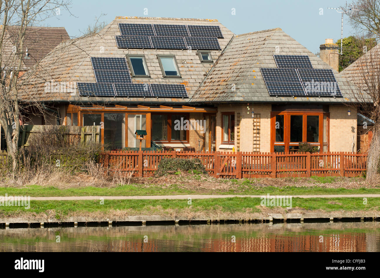 Solar panels on the roof of a house on the river Cam near Cambridge. England. Stock Photo