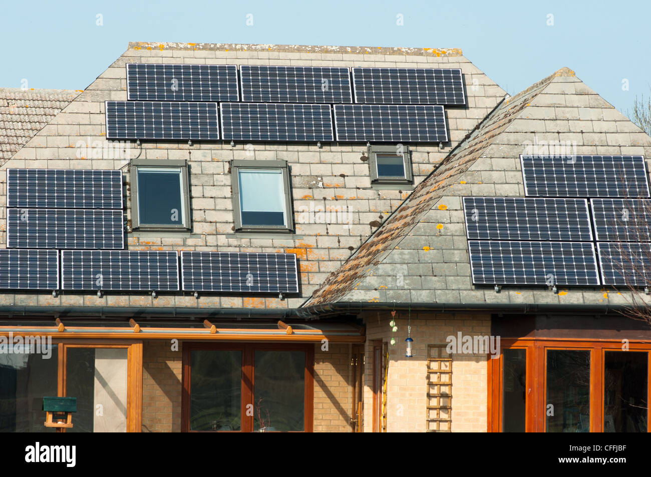 Solar panels on the roof of a house on the river Cam near Cambridge. England. - Stock Image