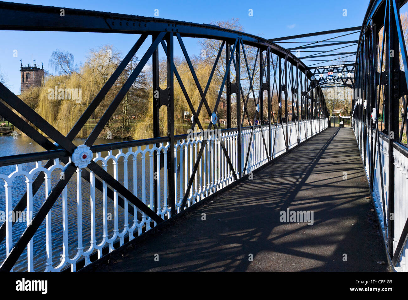 The 19thC Andresey footbridge over River Trent with  tower of St Modwen's Church to left, Burton-upon-Trent, - Stock Image