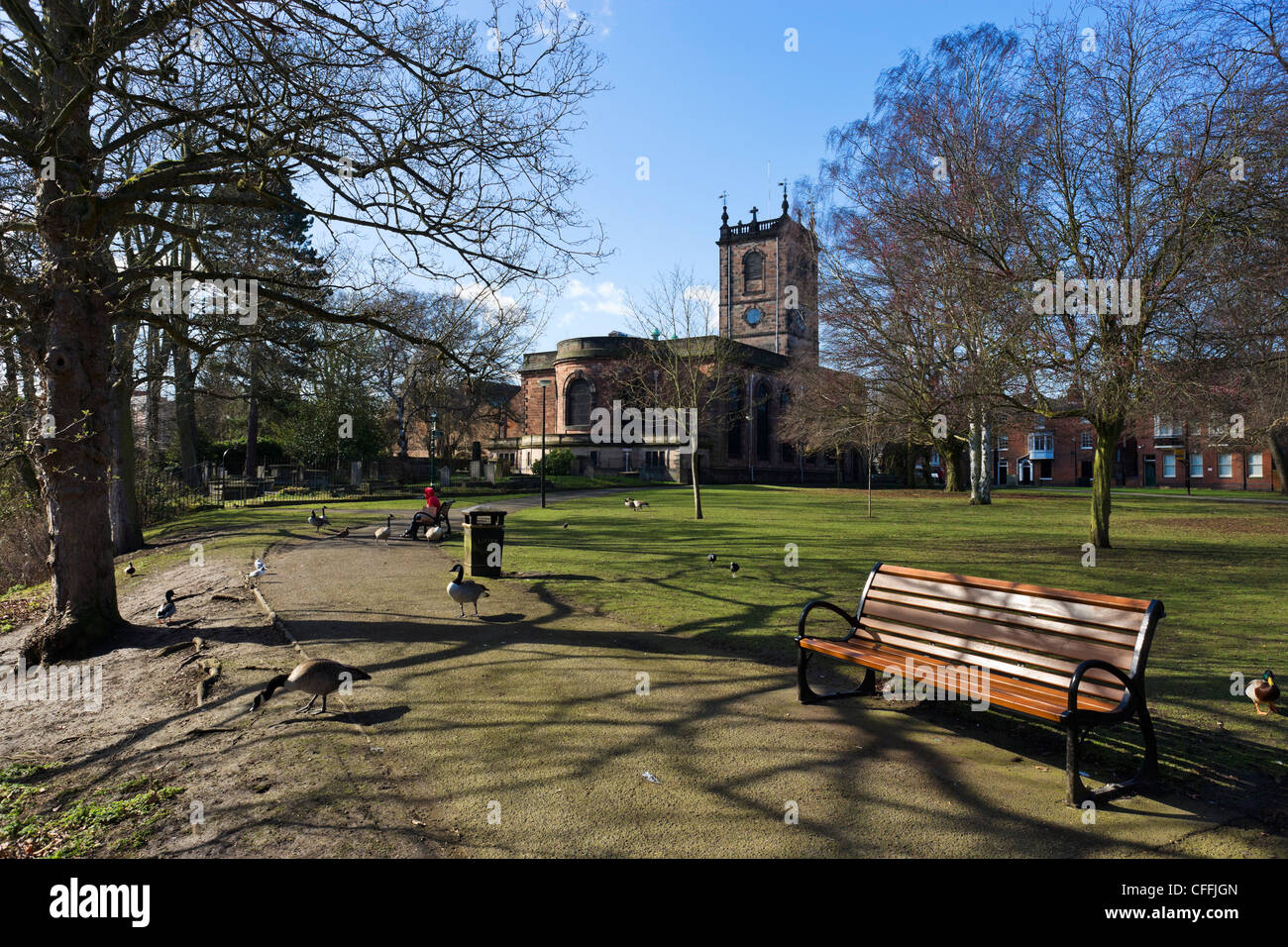 Park alongside the River Trent with St Modwen's Church behind, Burton-upon-Trent, Staffordshire, England, UK - Stock Image