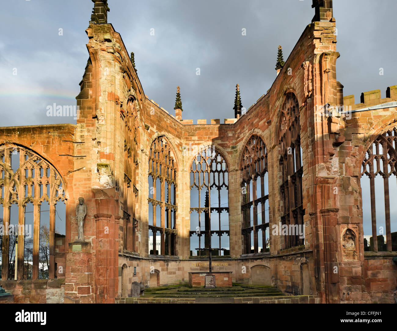 The altar of the old bombed out cathedral in late afternoon sunshine after a storm, Coventry, West Midlands, England, - Stock Image