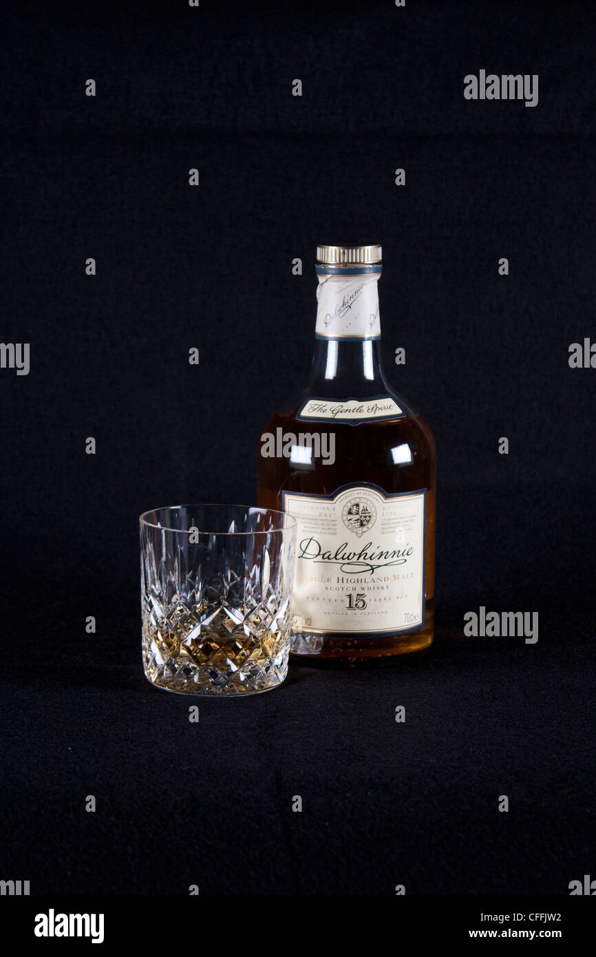 Dalwhinnie 15 year old Scotch Single Malt Whisky Bottle Low Key image with cut glass - Stock Image