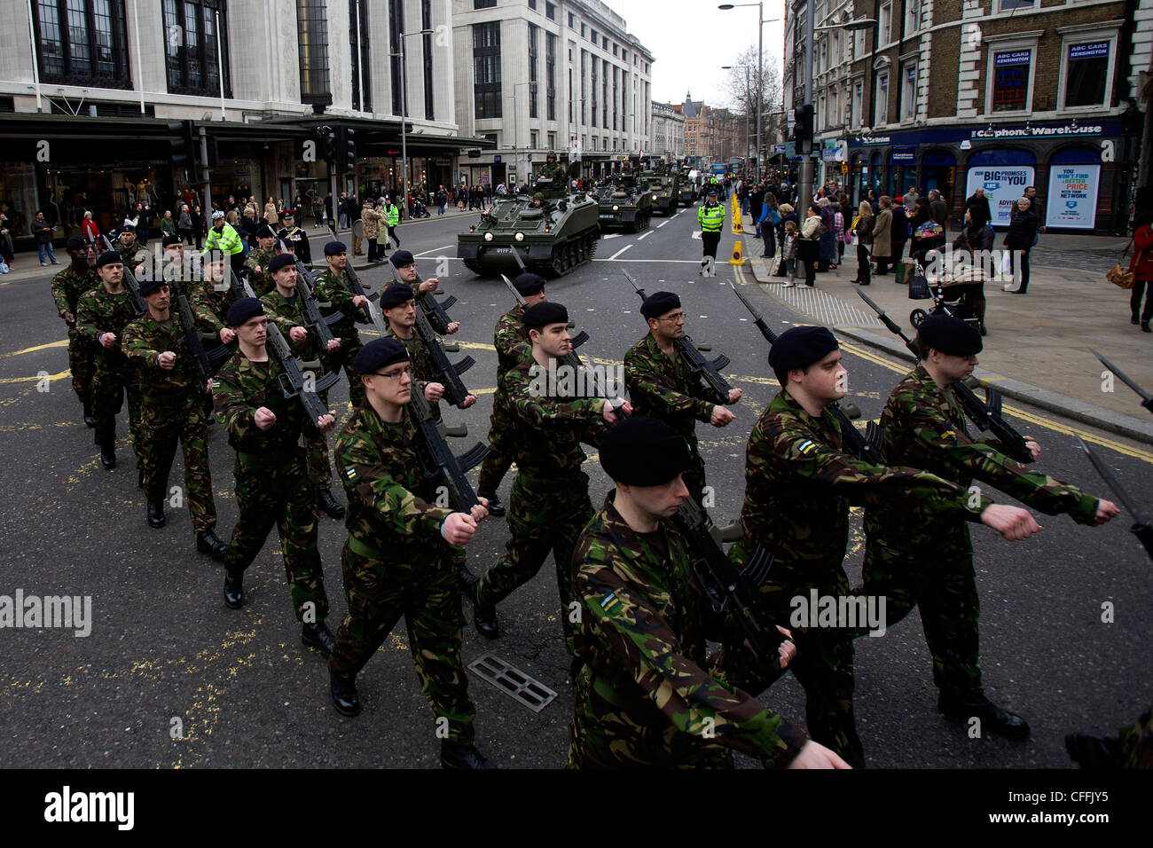 Territorial Army (TA) soldiers from The Royal Yeomanry Regiment march through the streets of Kensington Army parade - Stock Image