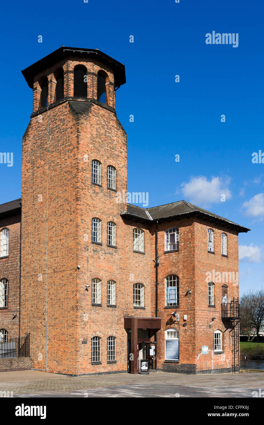 Derby Silk Mill on the banks of the River Derwent viewed from Cathedral Green, Derby, Derbyshire, East Midlands, - Stock Image