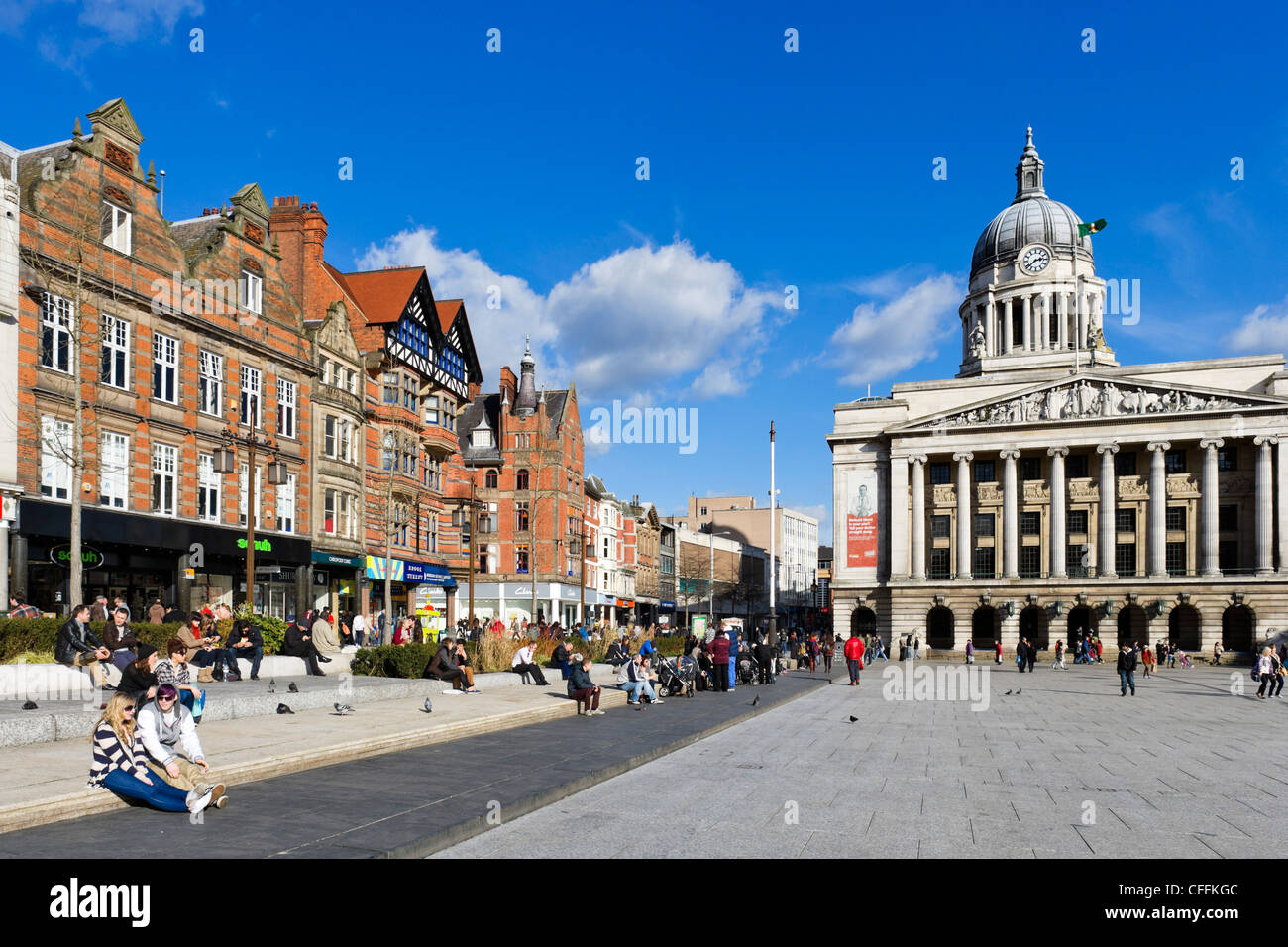 Shops on Old Market Square with the Council House (city hall) to the right, Nottingham, Nottinghamshire, England, - Stock Image
