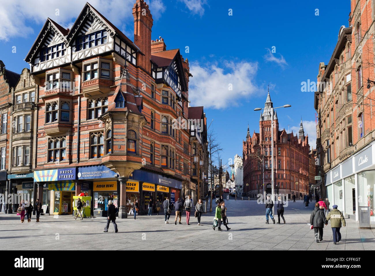 Shops at the junction of King Street and Long Row from  Old Market Square in the city centre, Nottingham, England, - Stock Image