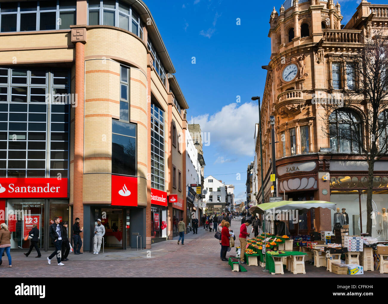 Shops at the junction of High Street and Long Row in the city centre, Nottingham, Nottinghamshire, England, UK Stock Photo