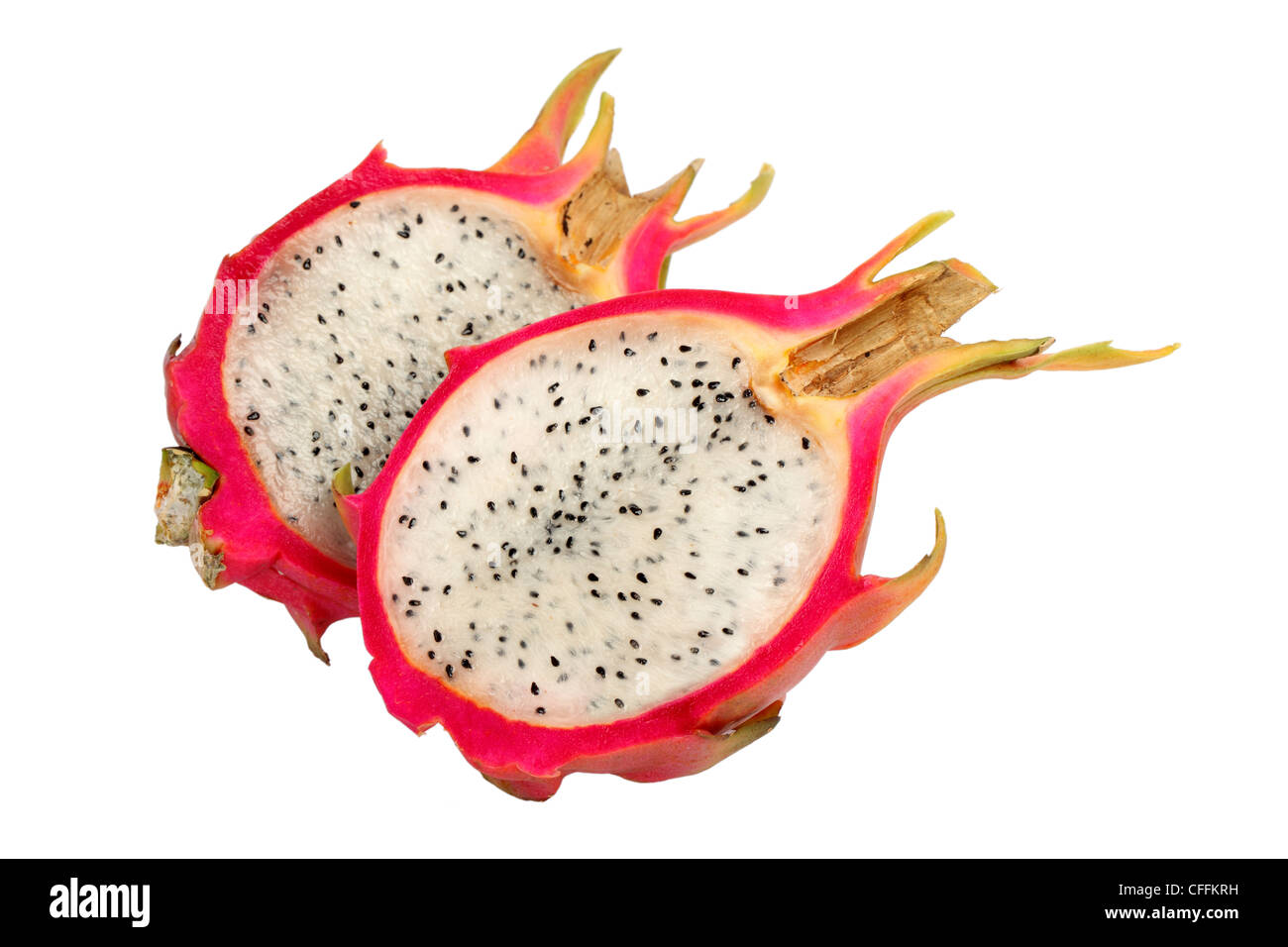 Sliced Dragonfruit cut out on white background - Stock Image