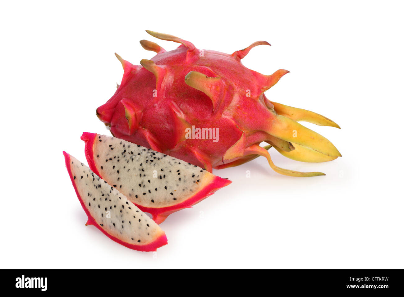 Whole and sliced Dragonfruit cut out on white background - Stock Image