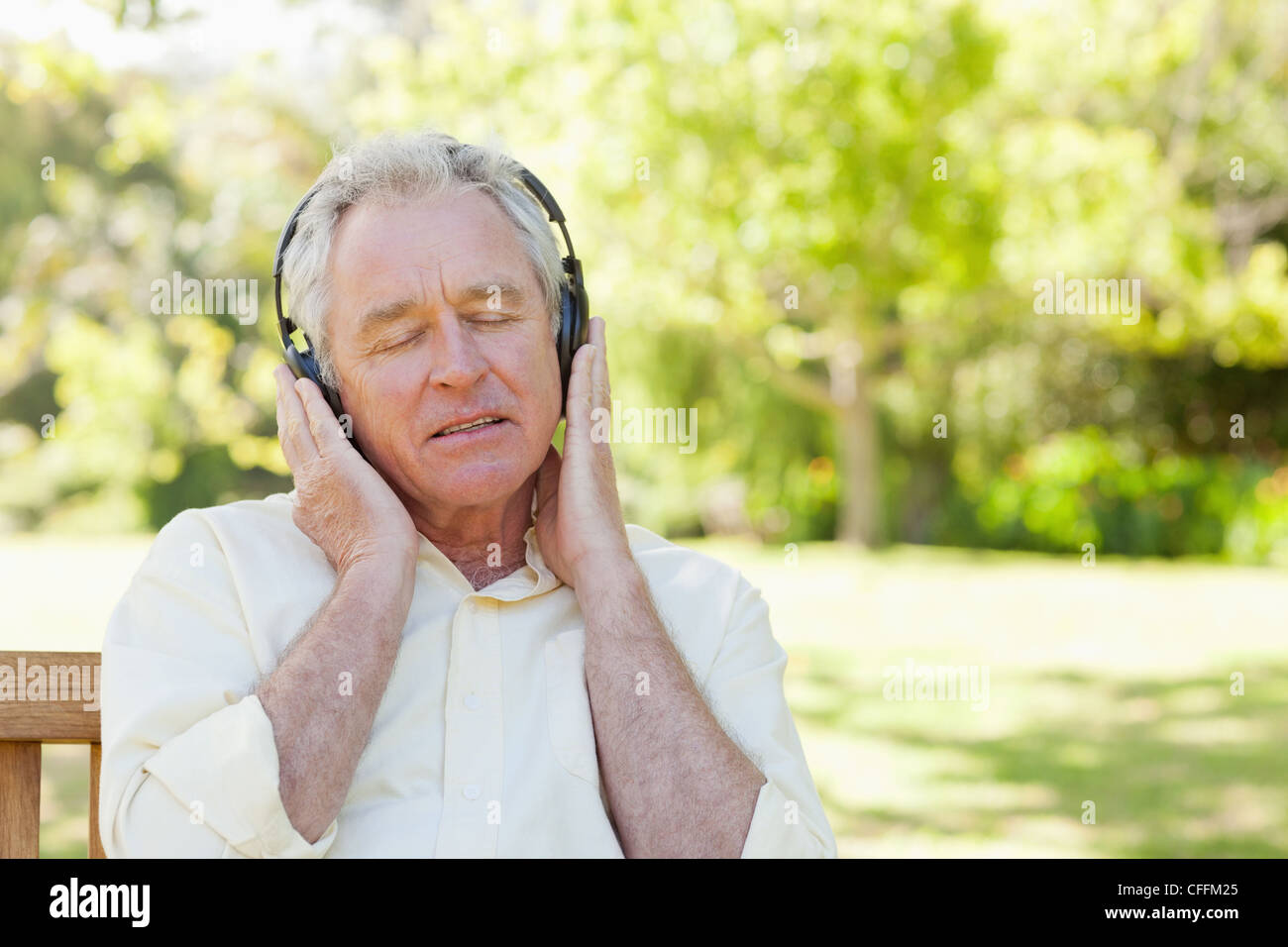 Man seriously listens to music - Stock Image