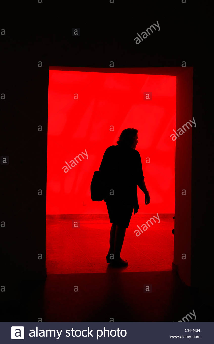 Venice Italy Biennale woman in a red - Stock Image