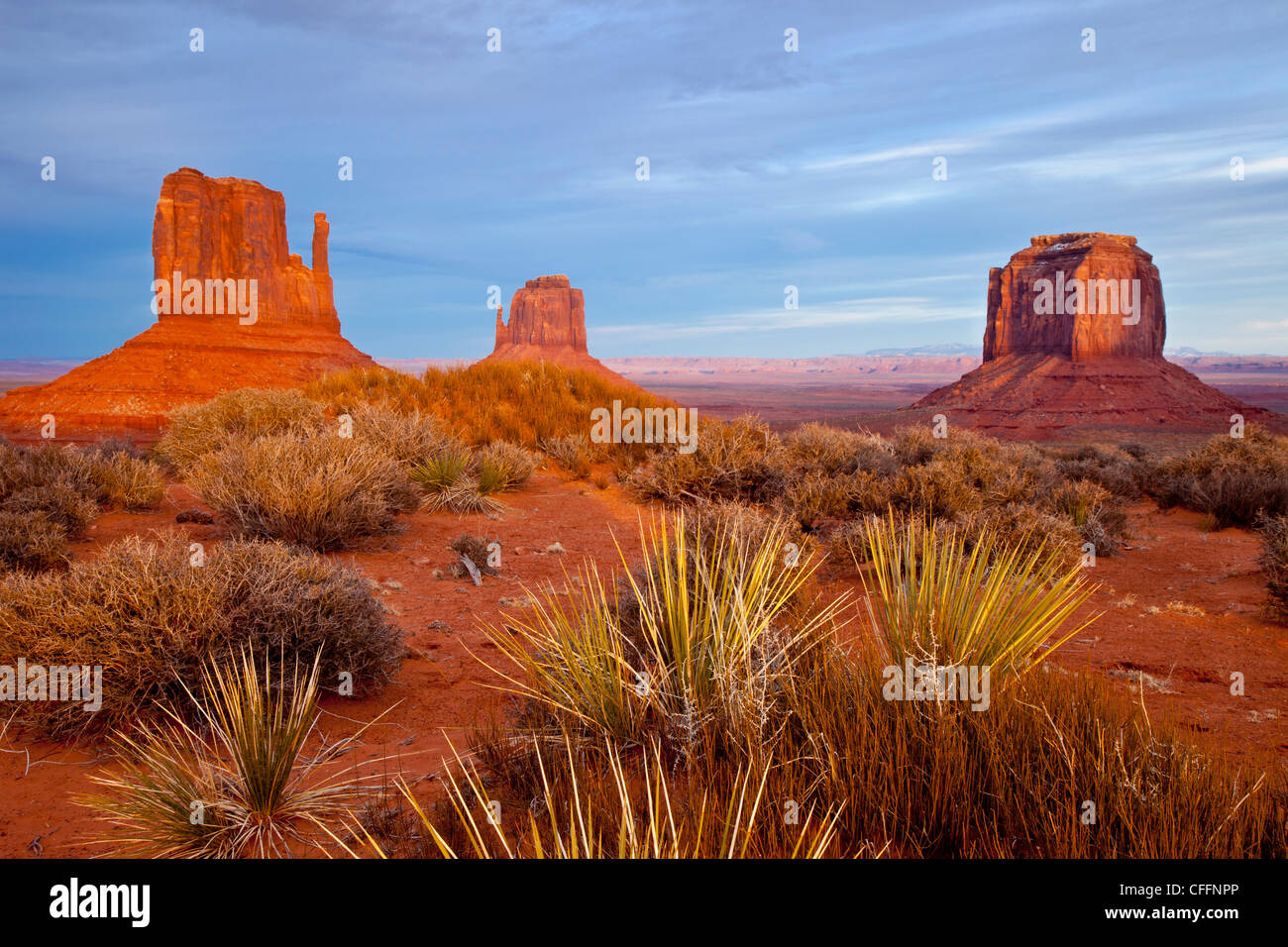 Sunset over the Mittens and Merrick Butte, Monument Valley, Arizona USA - Stock Image