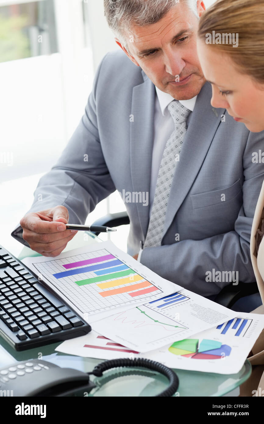 Business people working on statistic - Stock Image