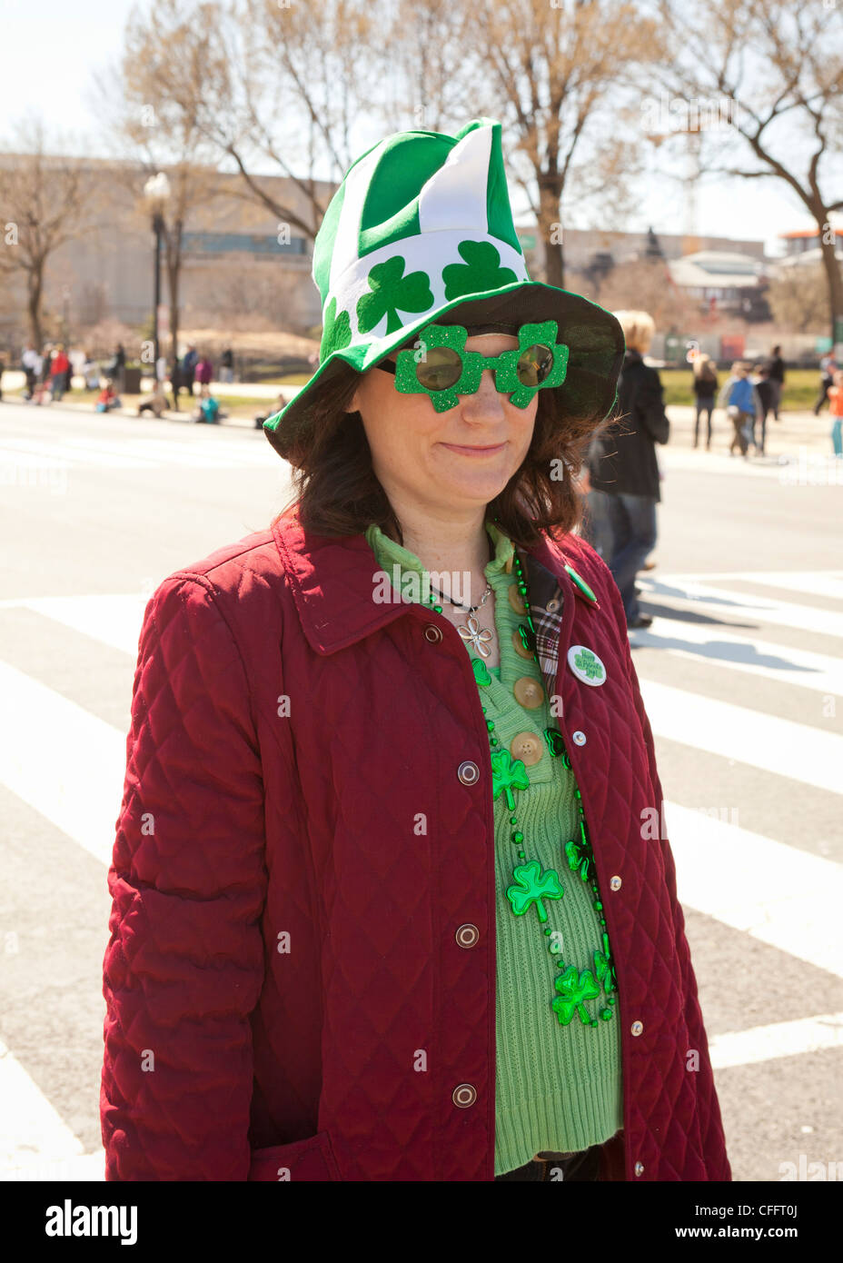 A female St. Patrick's Day parade participant - Stock Image