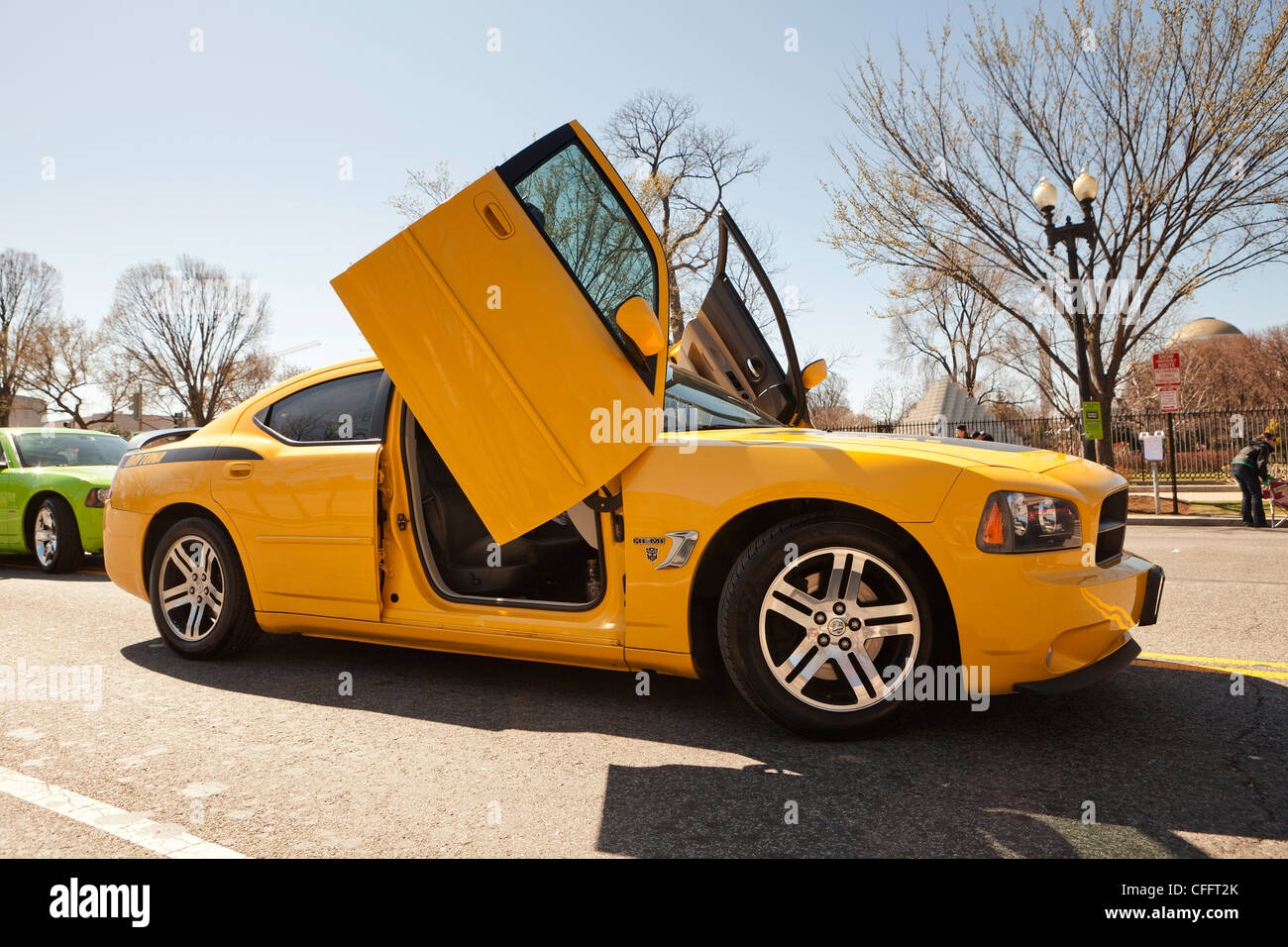 A late model Dodge Charger with modified scissor doors - Stock Image