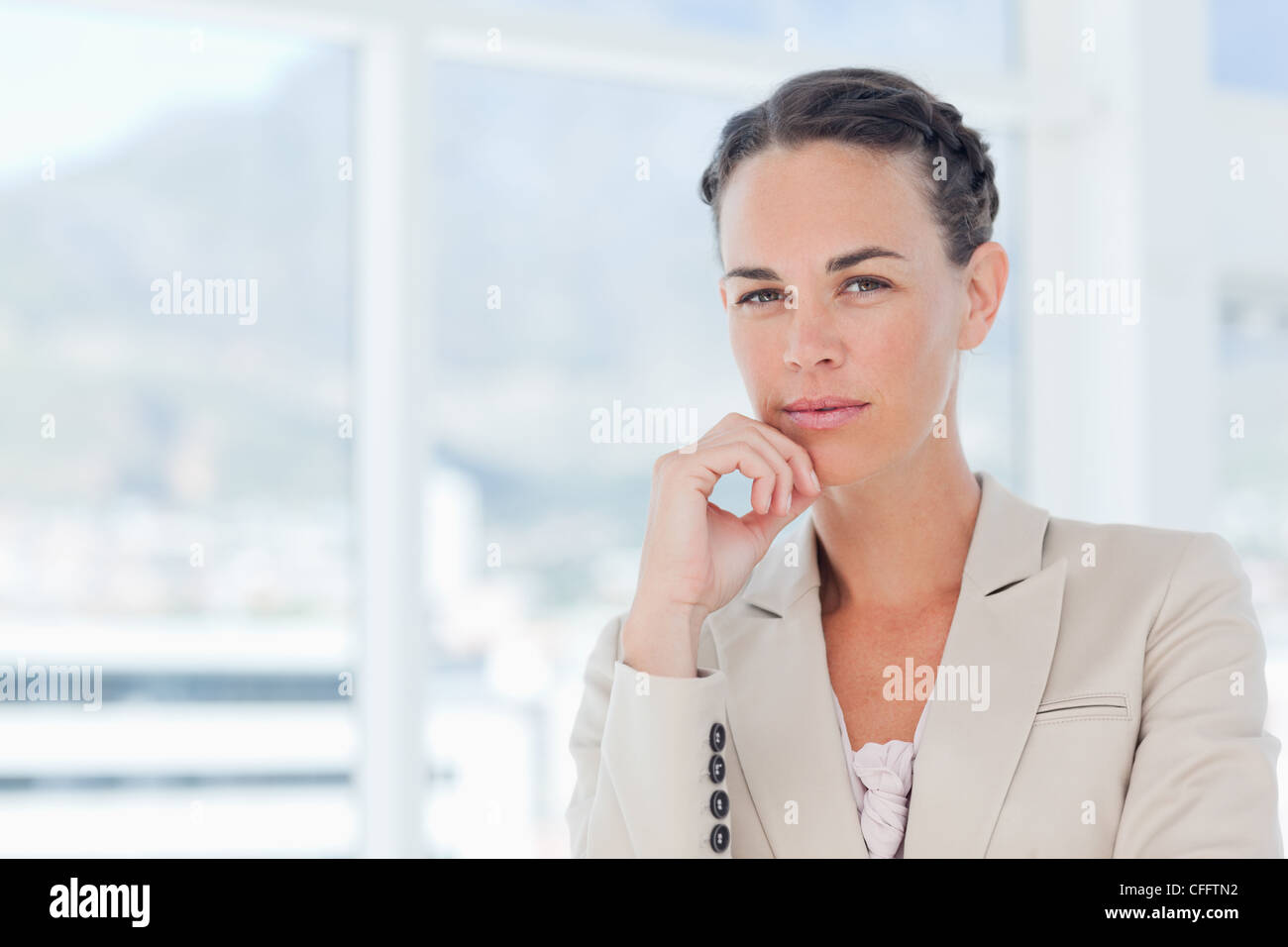 Saleswoman in thinkers pose - Stock Image