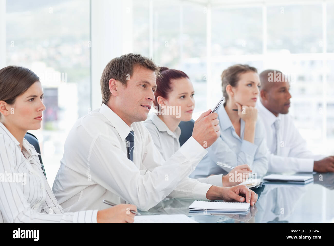 Salesteam sitting in a negotiation - Stock Image