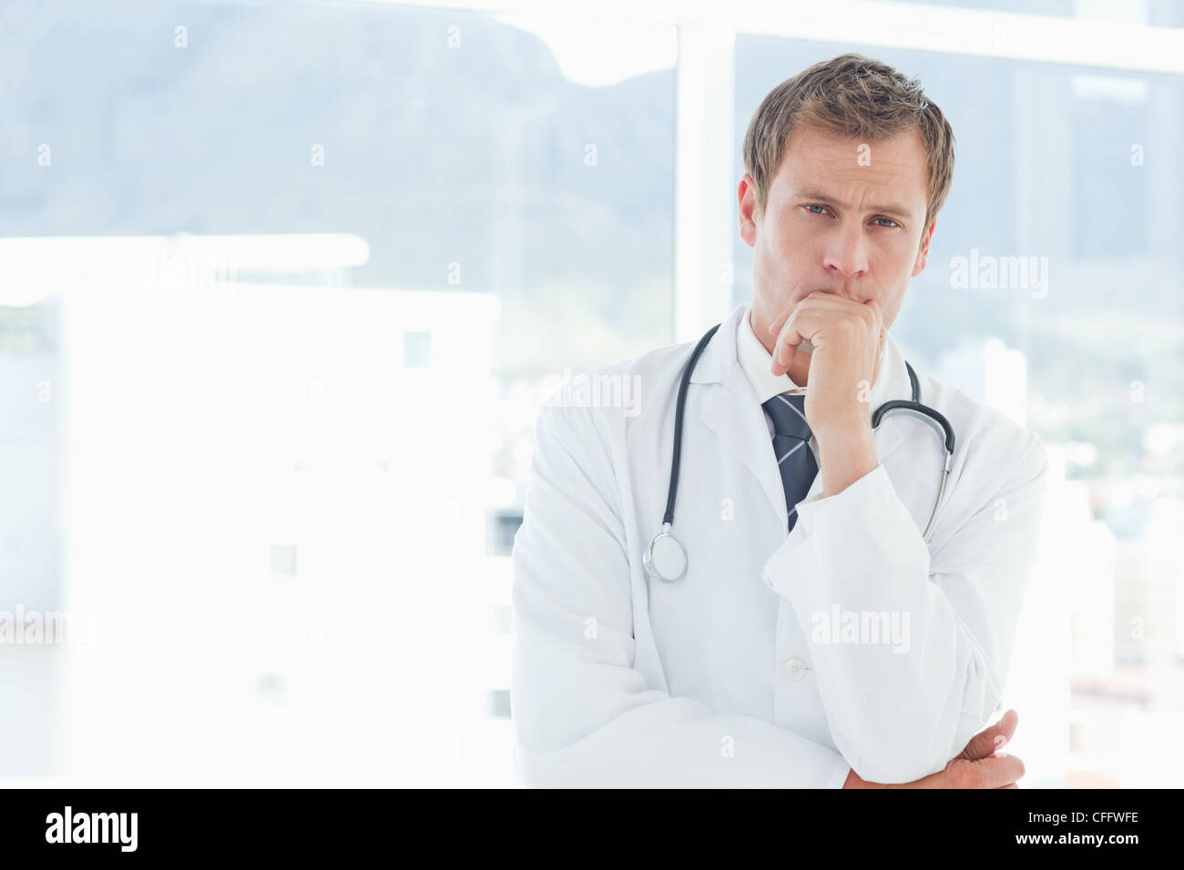Doctor in thinkers pose - Stock Image