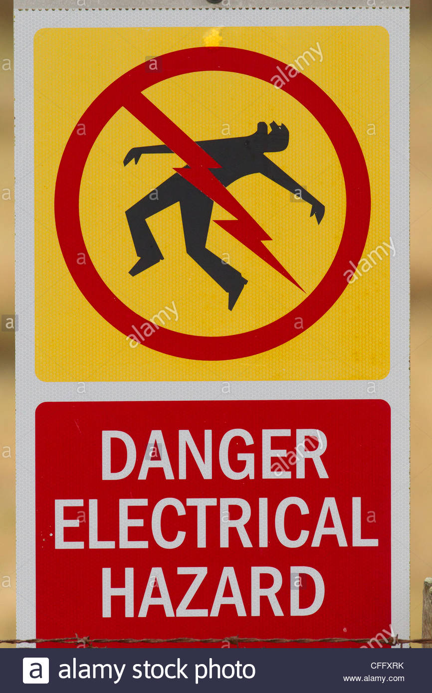 A sign reading 'danger electrical hazard' warns people not to enter an electrical facility in British Columbia, - Stock Image