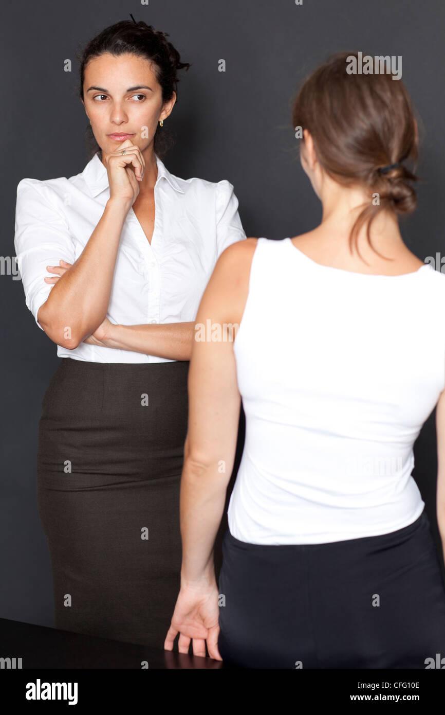 Mistrust between woman Stock Photo