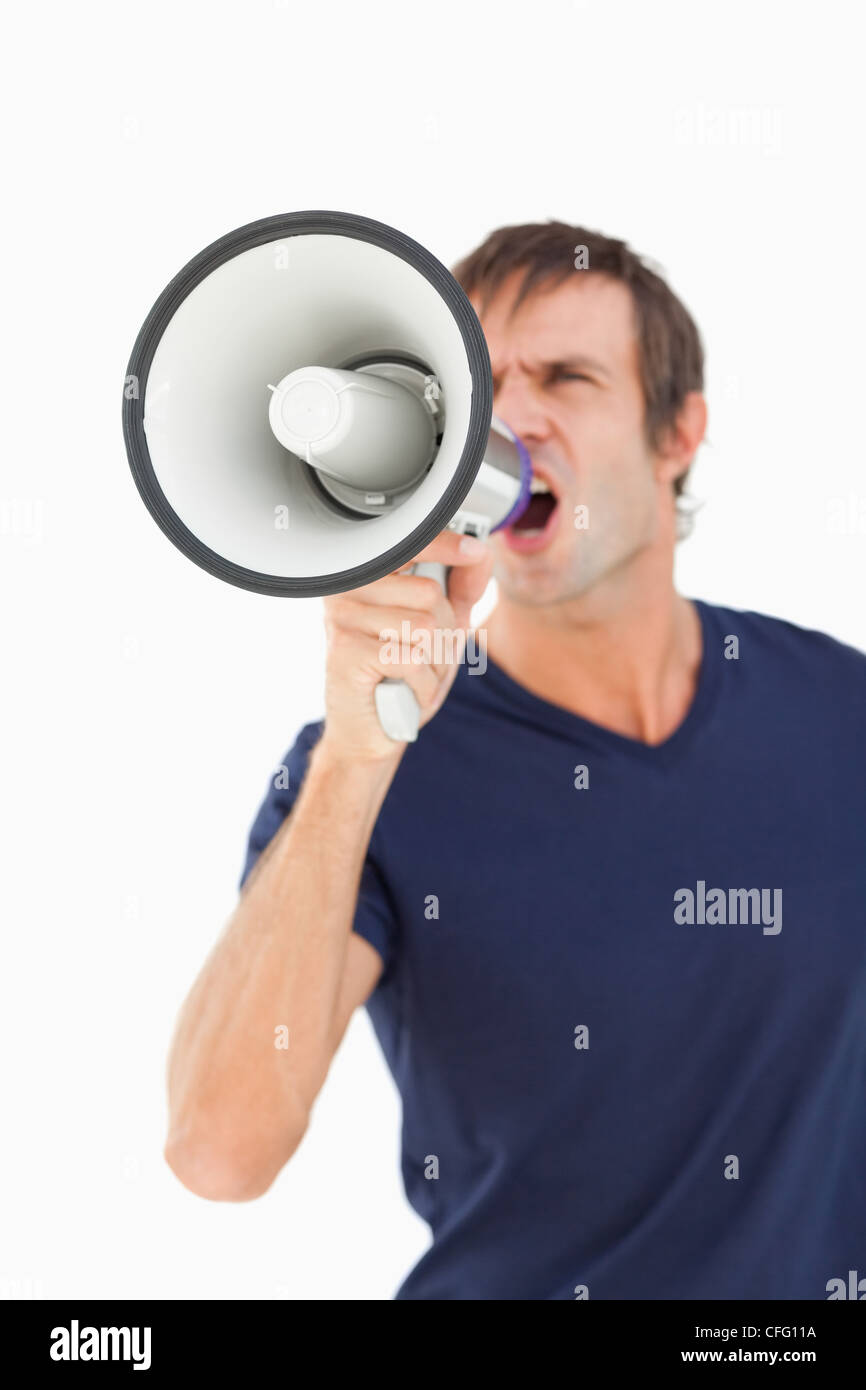 Megaphone held by a furious man - Stock Image