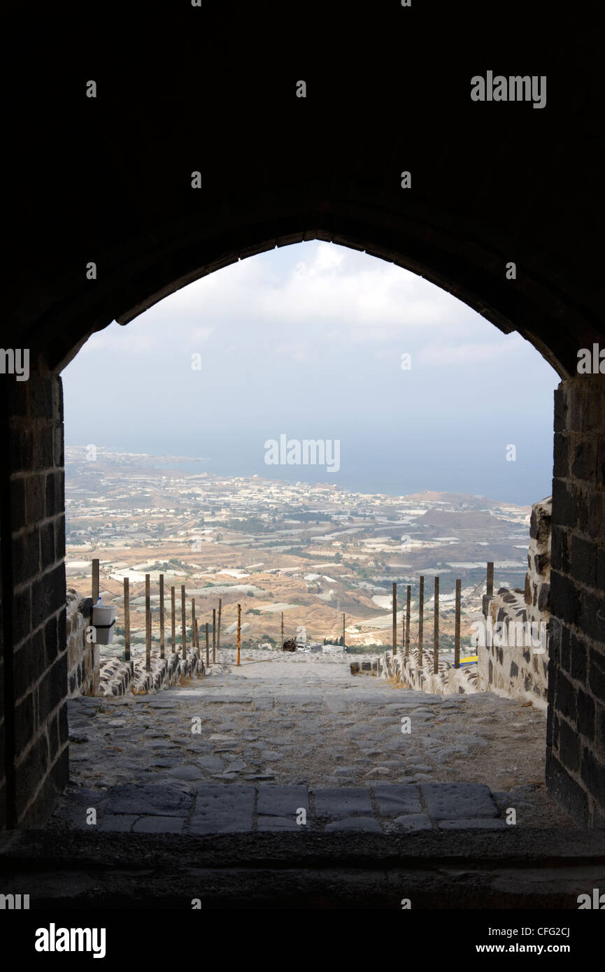 Qalaat Marqab. Syria. View of the coastal plain and Mediterranean through the arched entrance of the crusader castle. - Stock Image