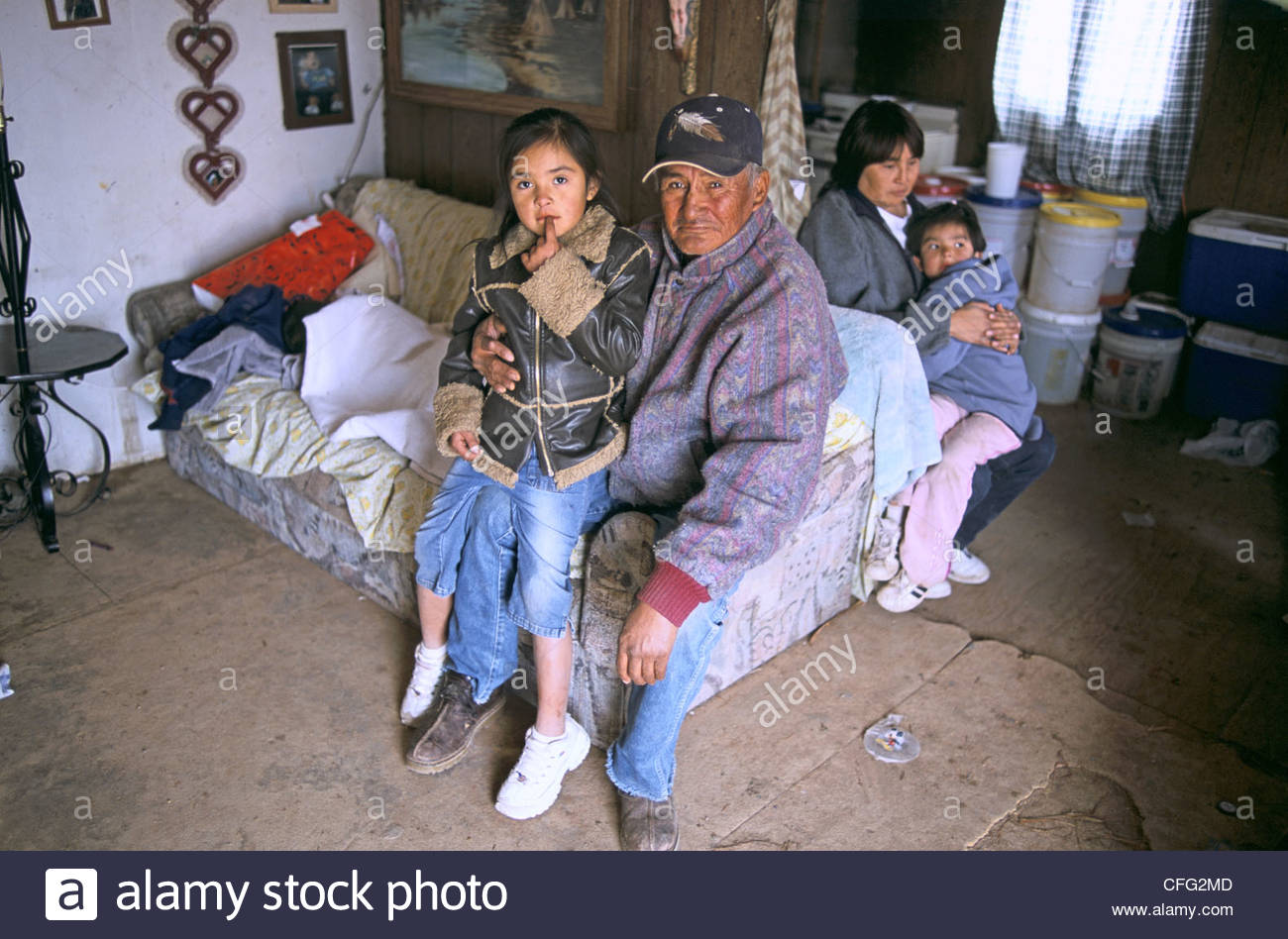 A Navajo woman with her father and her children. - Stock Image