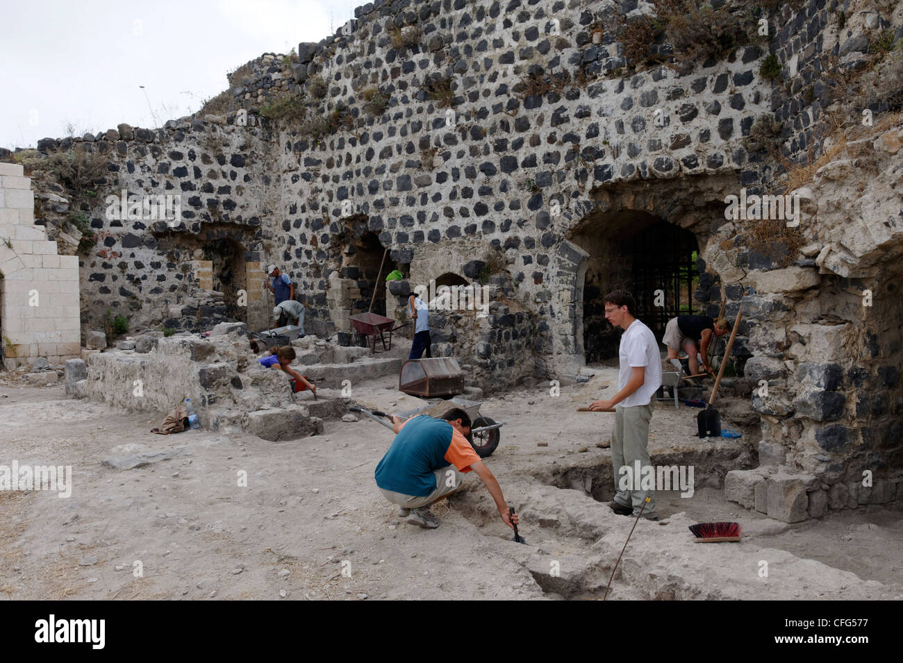 Qalaat Marqab. Syria. View of archaeologists excavating and restoring and section of the crusader castle. Qalaat - Stock Image