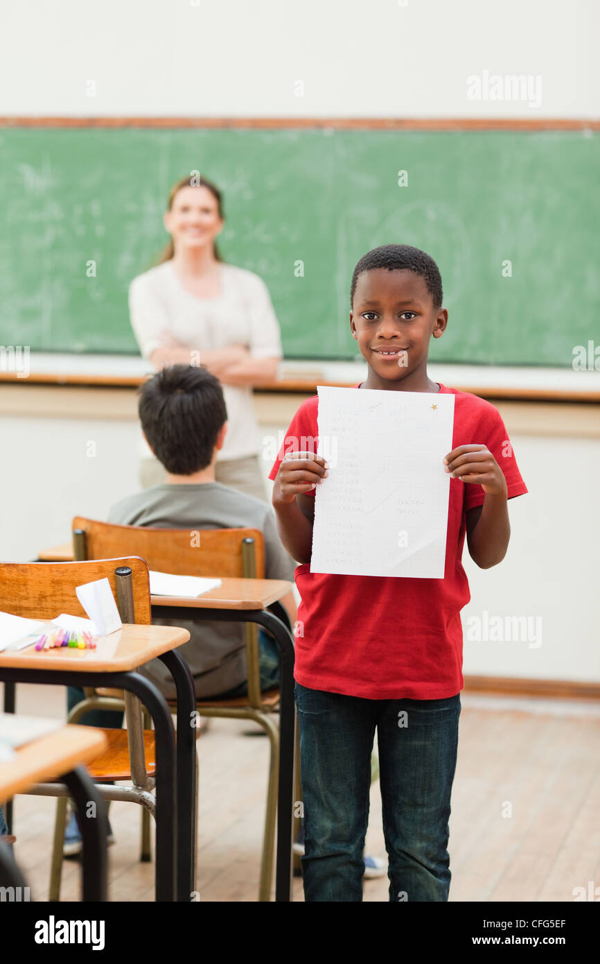 Student showing his report card - Stock Image