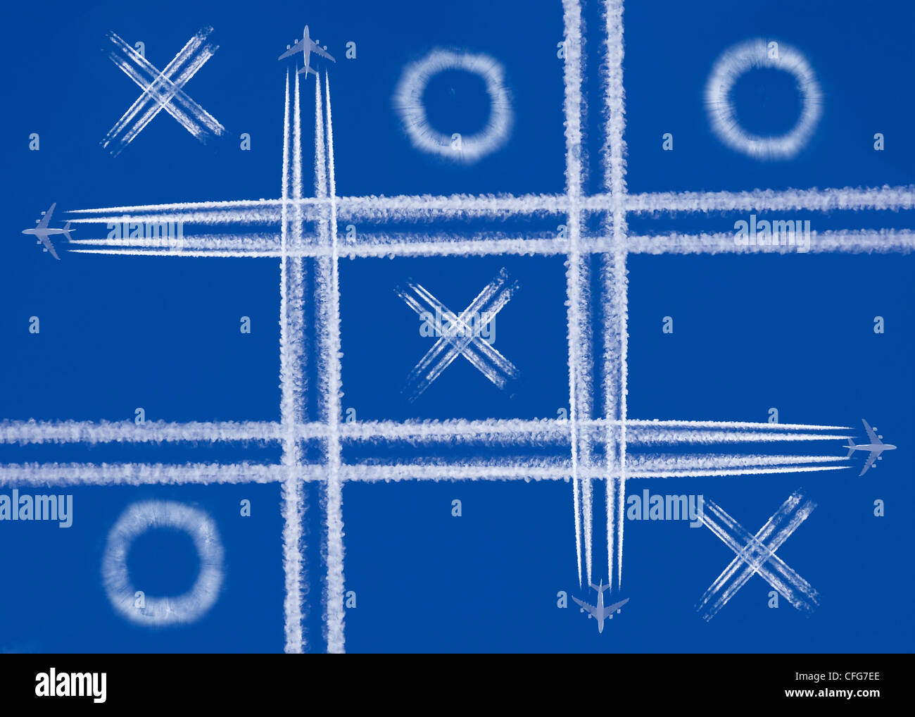 four planes playing in the sky - Stock Image