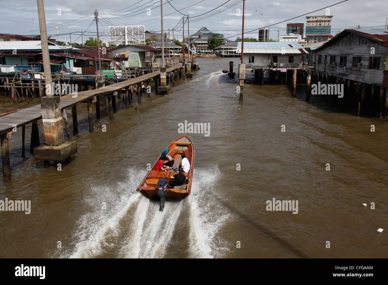 Speedboats and river taxis in water village in Bandar Seri Begawan, Brunei  - Stock Image