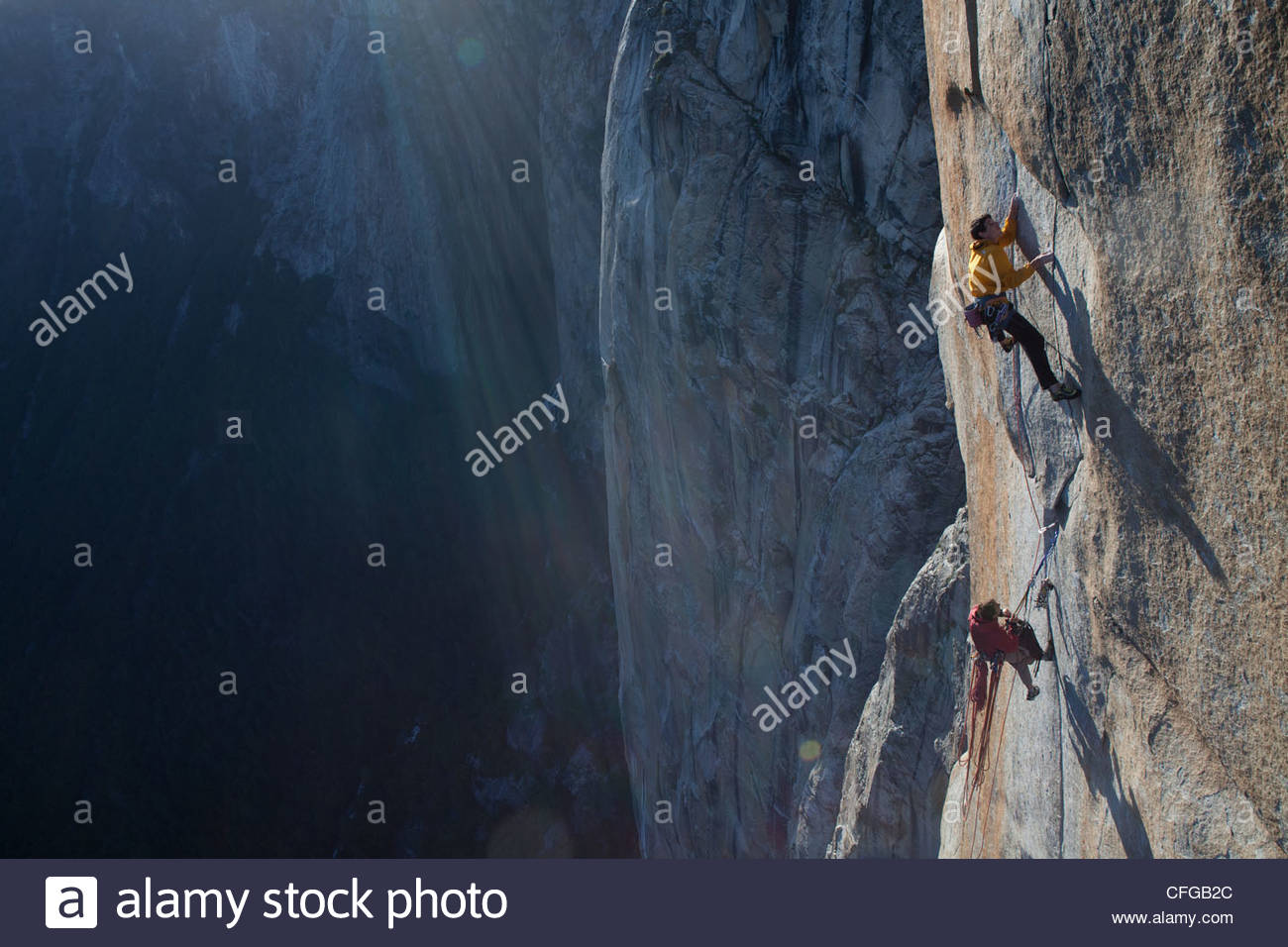 climbers, without ropes, grip an expanse of el capitan stock photo