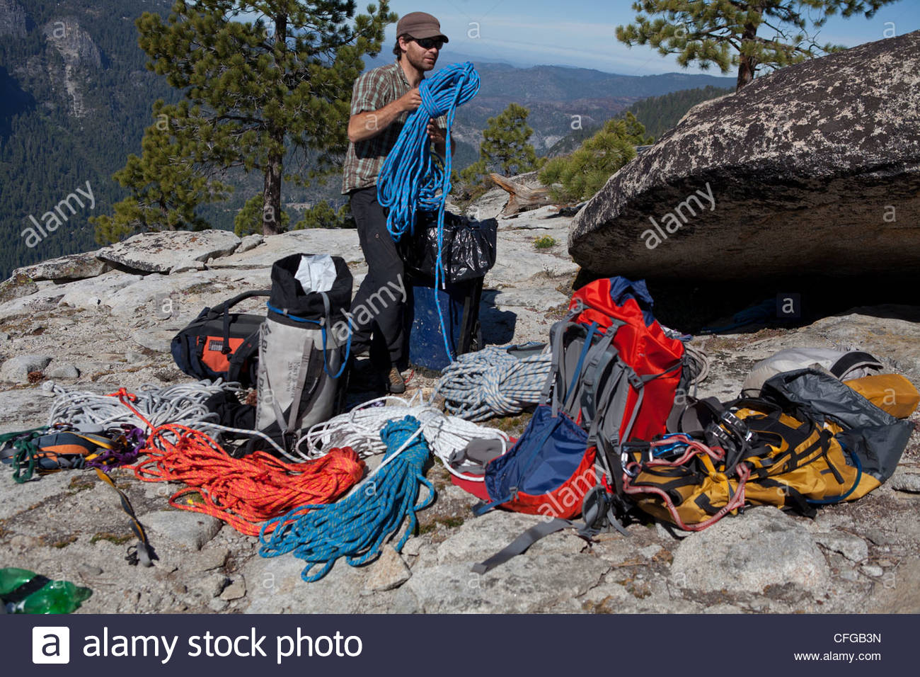 A photo assistant packs the 1500 feet of rope needed to rappel down El Capitan. - Stock Image