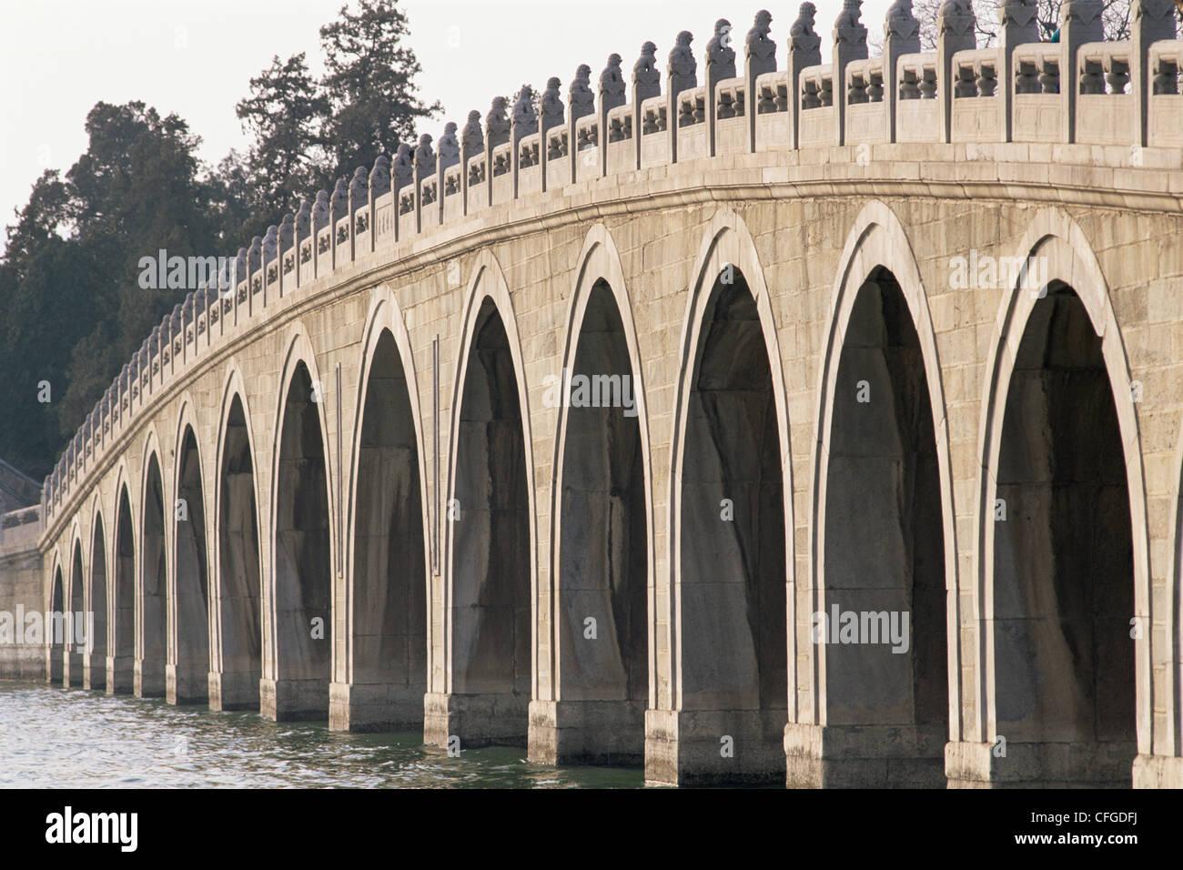 China, Beijing, Summer Palace, Seventeen Arched Bridge - Stock Image