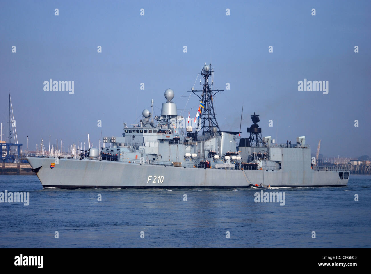 The German navy ship 'Emden' leaves Portsmouth Dockyard in the UK following a 3 day visit to the Hampshire - Stock Image