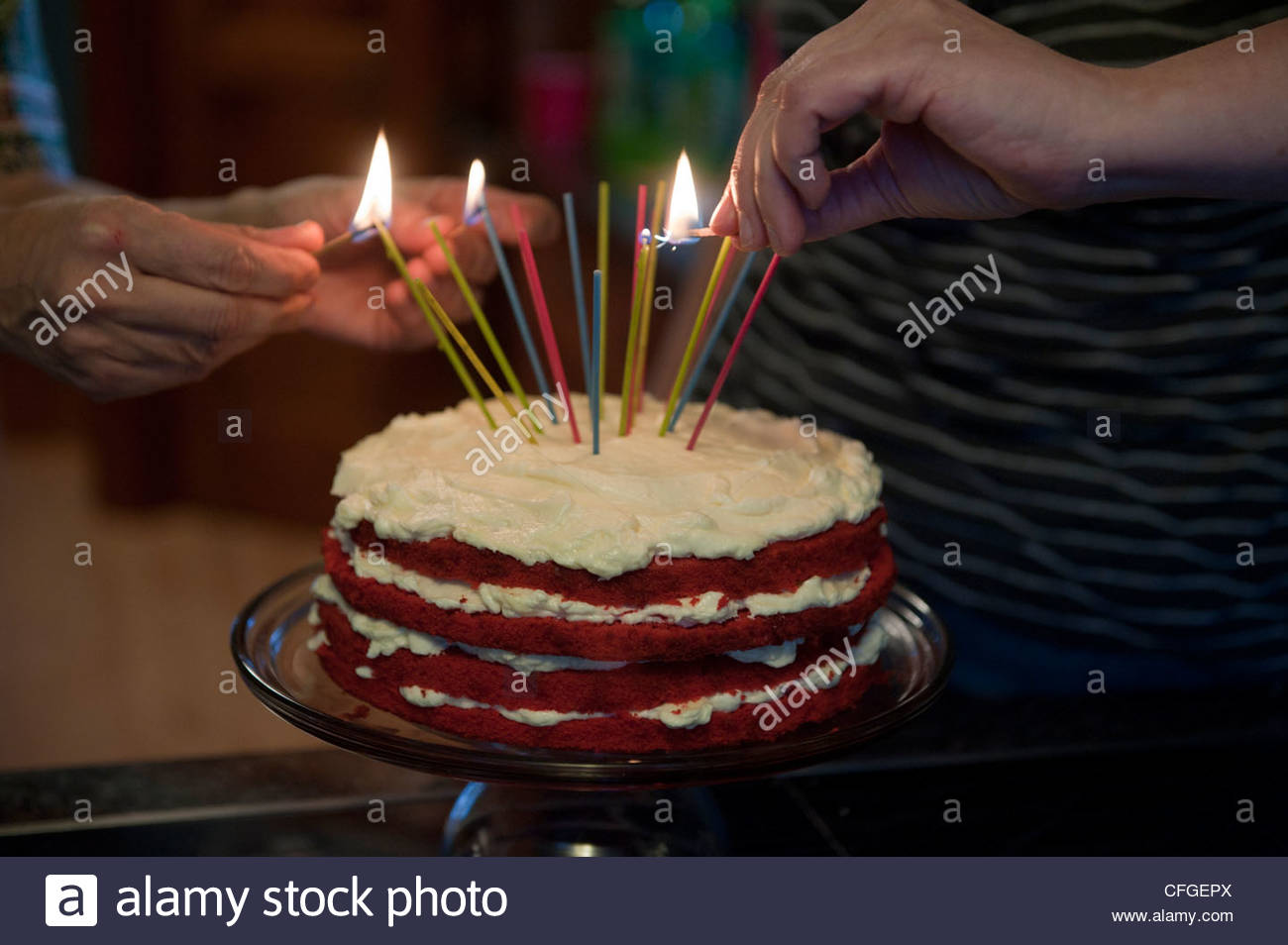 Candles Are Lit On A Birthday Cake