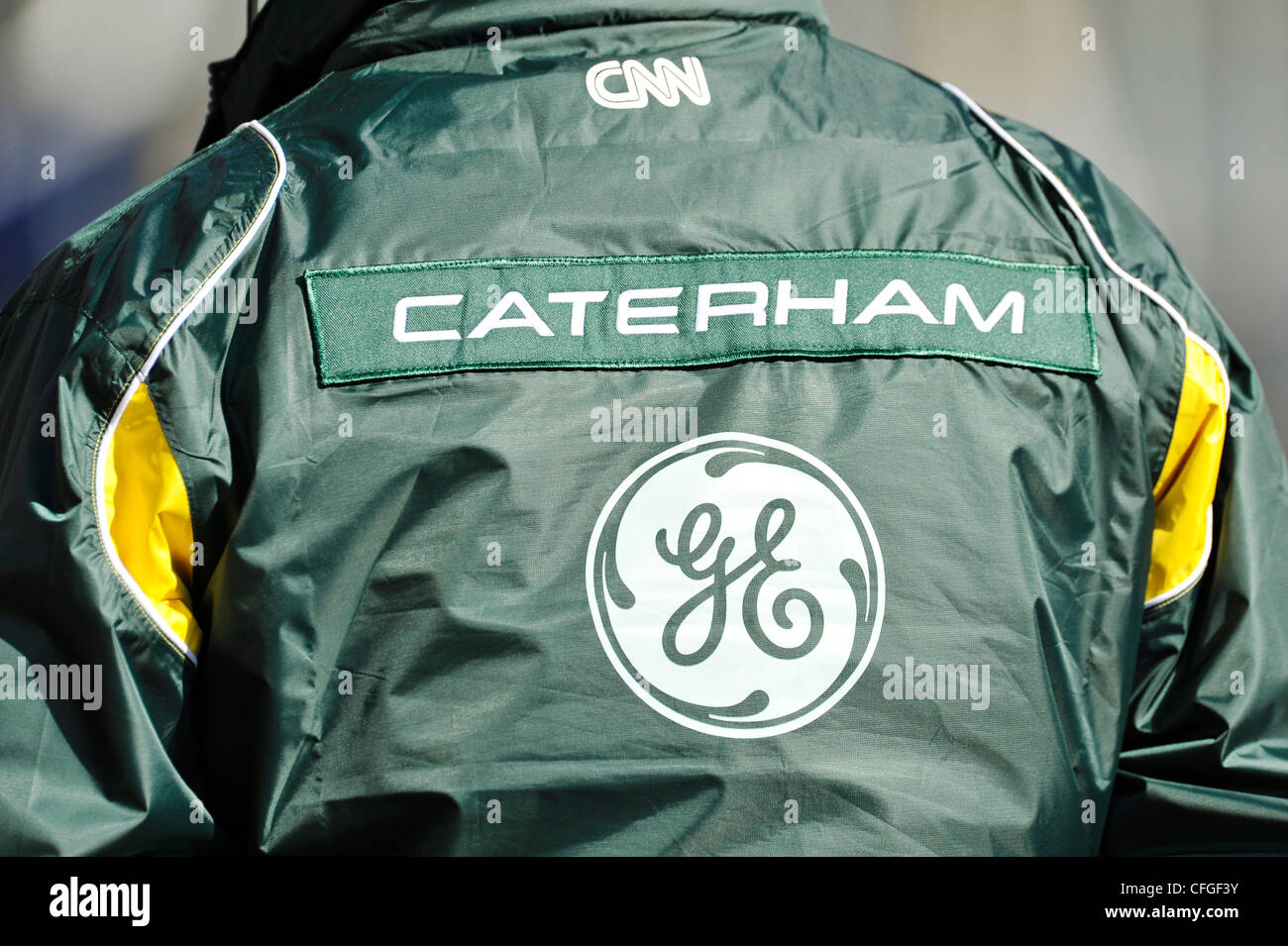 Caterham brand logo on jacket of team member during Formula One testing sessions on Circuito Catalunya, Spain - Stock Image