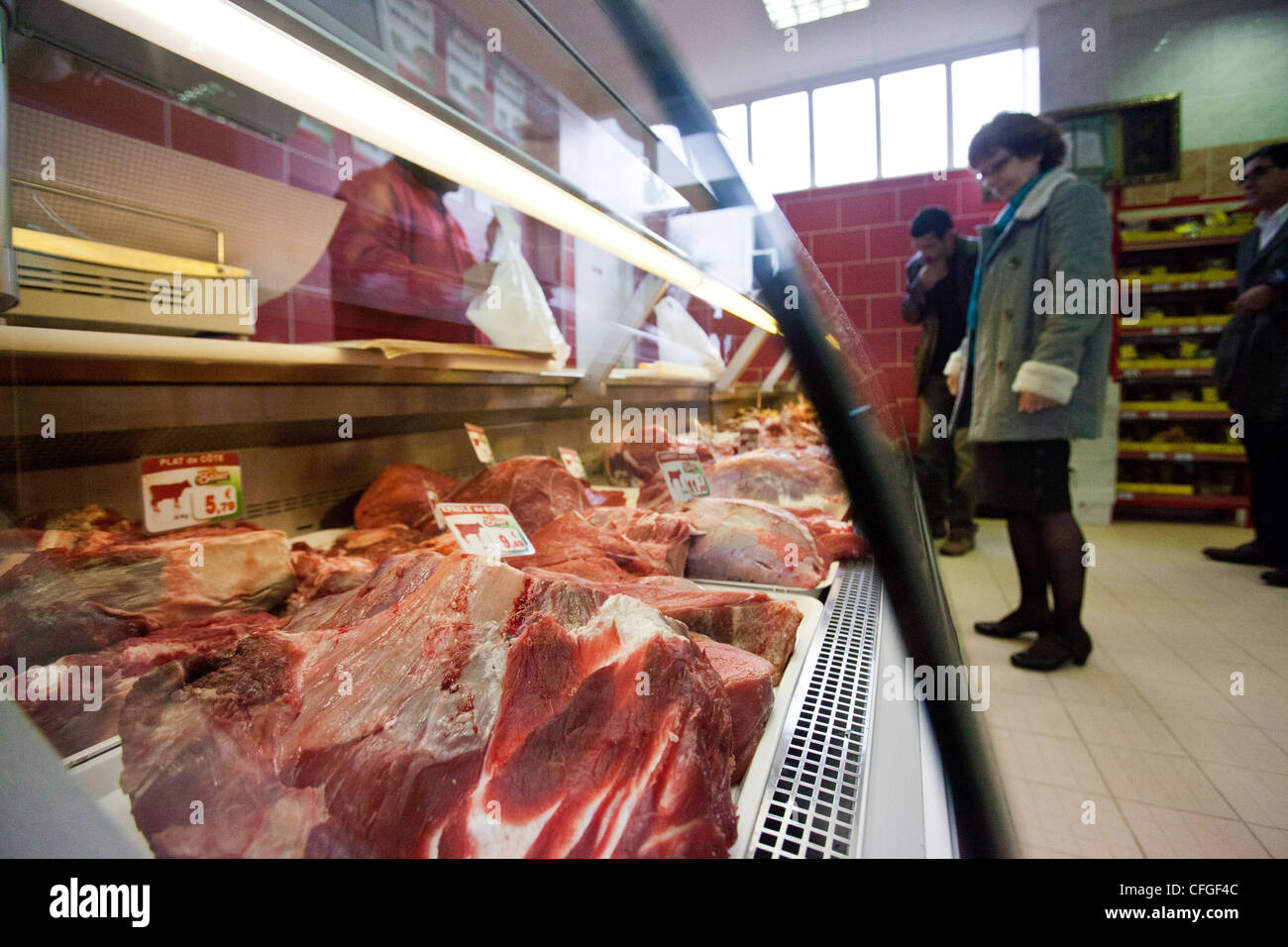 Customers Choose Their Halal Meat At A Halal Supermarket In Nantes