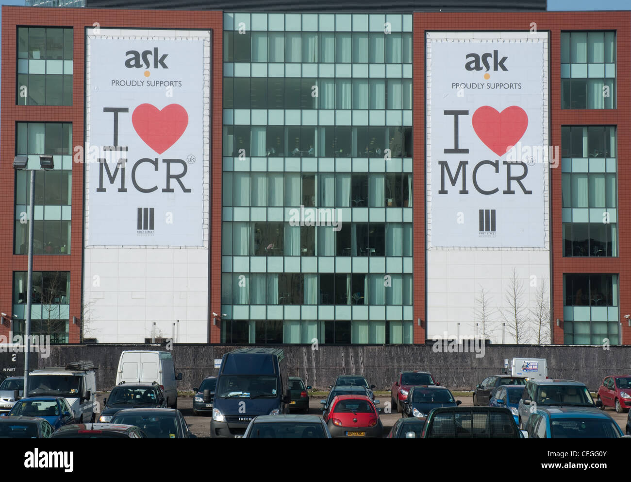 I Love Manchester banners on the outside of Number One First Street, Manchester City Council offices. - Stock Image