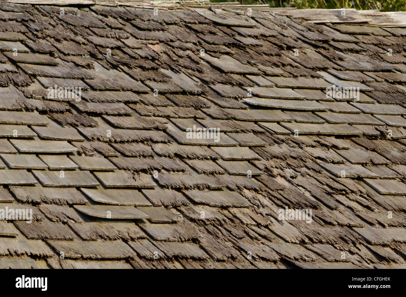 Badly decaying and rotting wooden shingle roof. Damaged wood texture, wooden structure. [FOCUS POINT note in Description.] - Stock Image