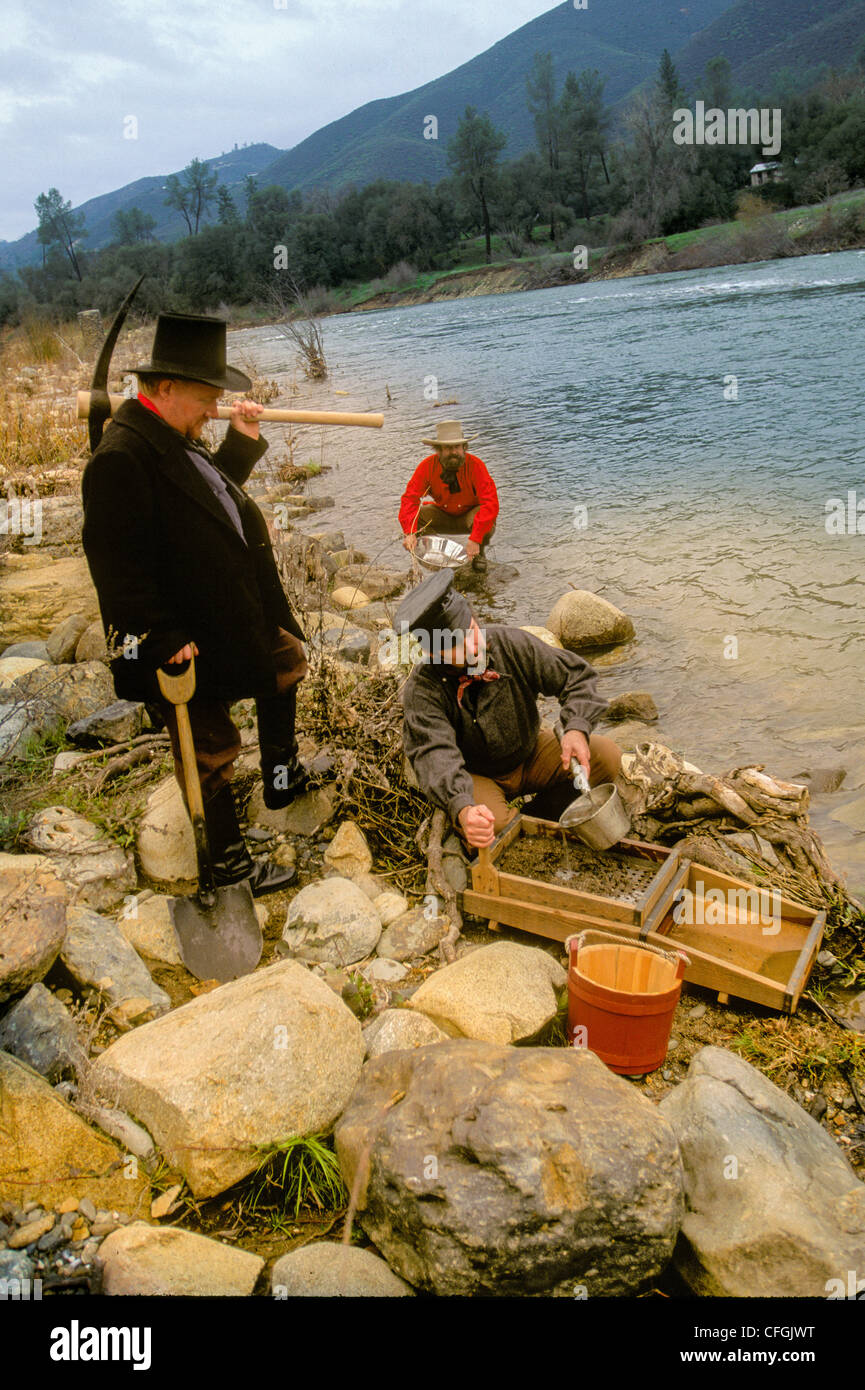 Costumed prospectors recreate panning for gold in traditional 19C costume in Coloma Gold Country, Northern California - Stock Image
