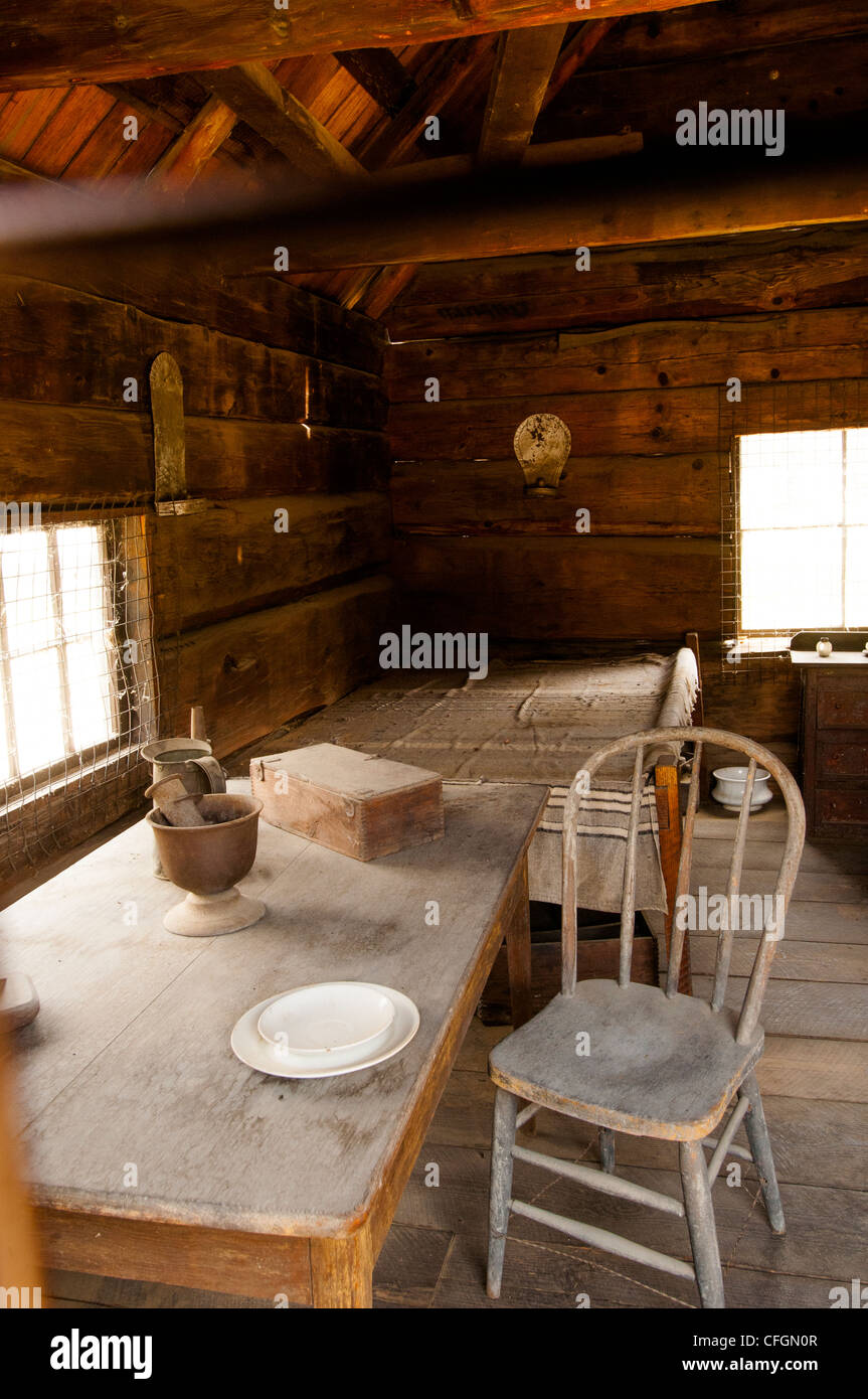 Interior of 19C Mormon log cabin in the Marshall Discovery State Park in Gold Rush country of Coloma Northern California Stock Photo
