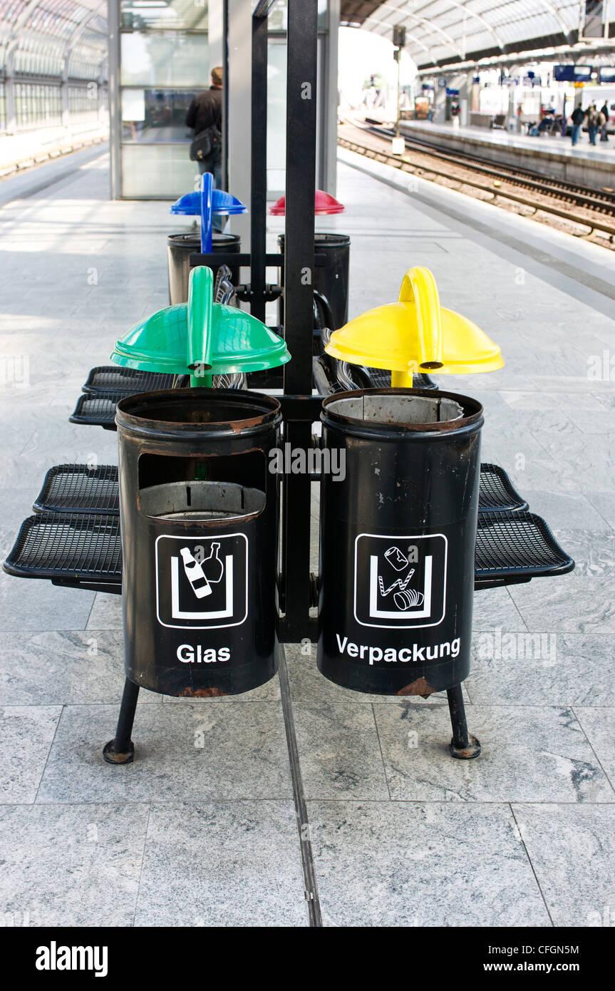 Recycling bins on train platform in Berlin, Germany. - Stock Image