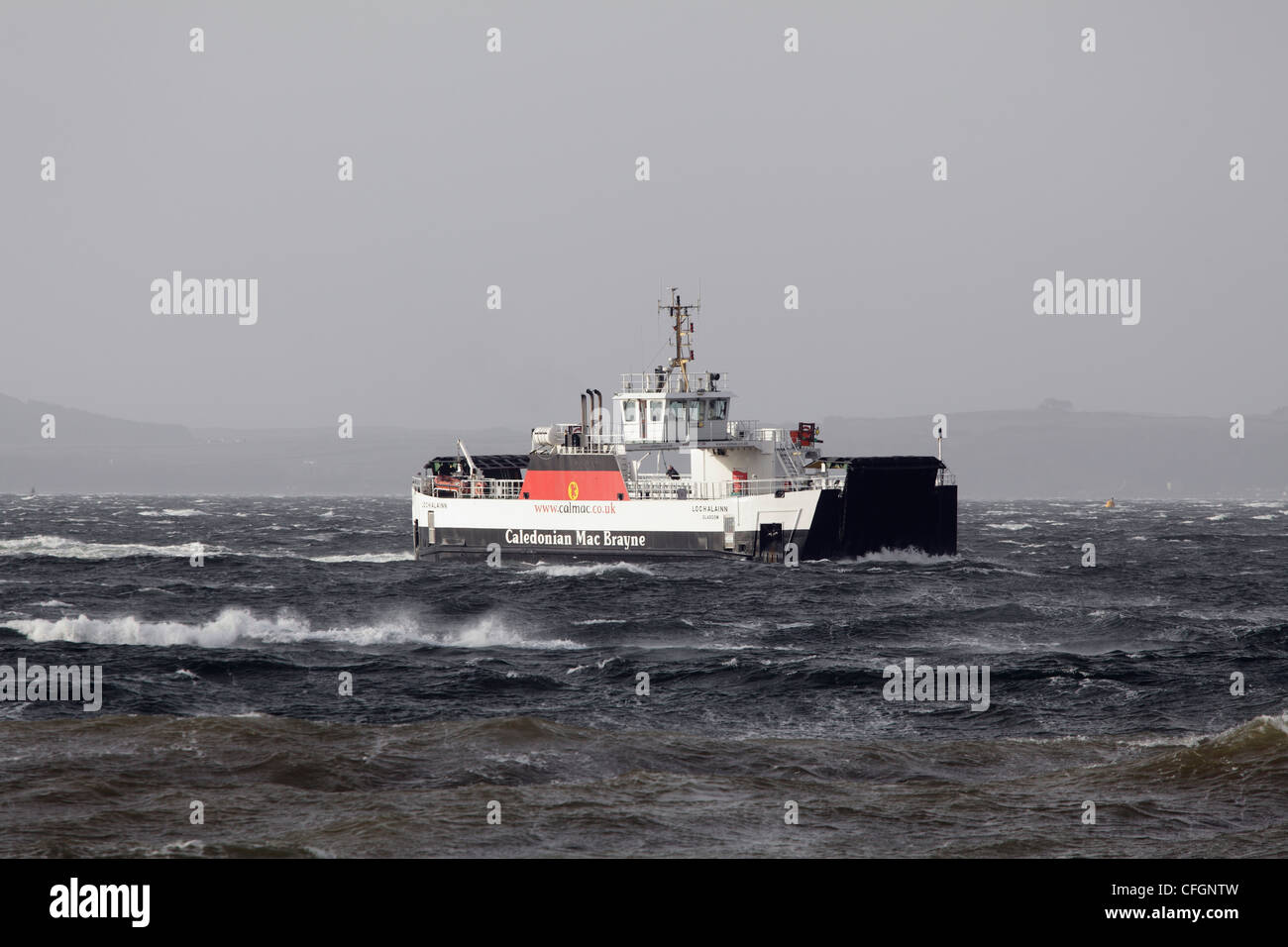 The Calmac Ferry Loch Alainn in bad weather approaching Largs from Great Cumbrae on the River Clyde Ayrshire Scotland - Stock Image