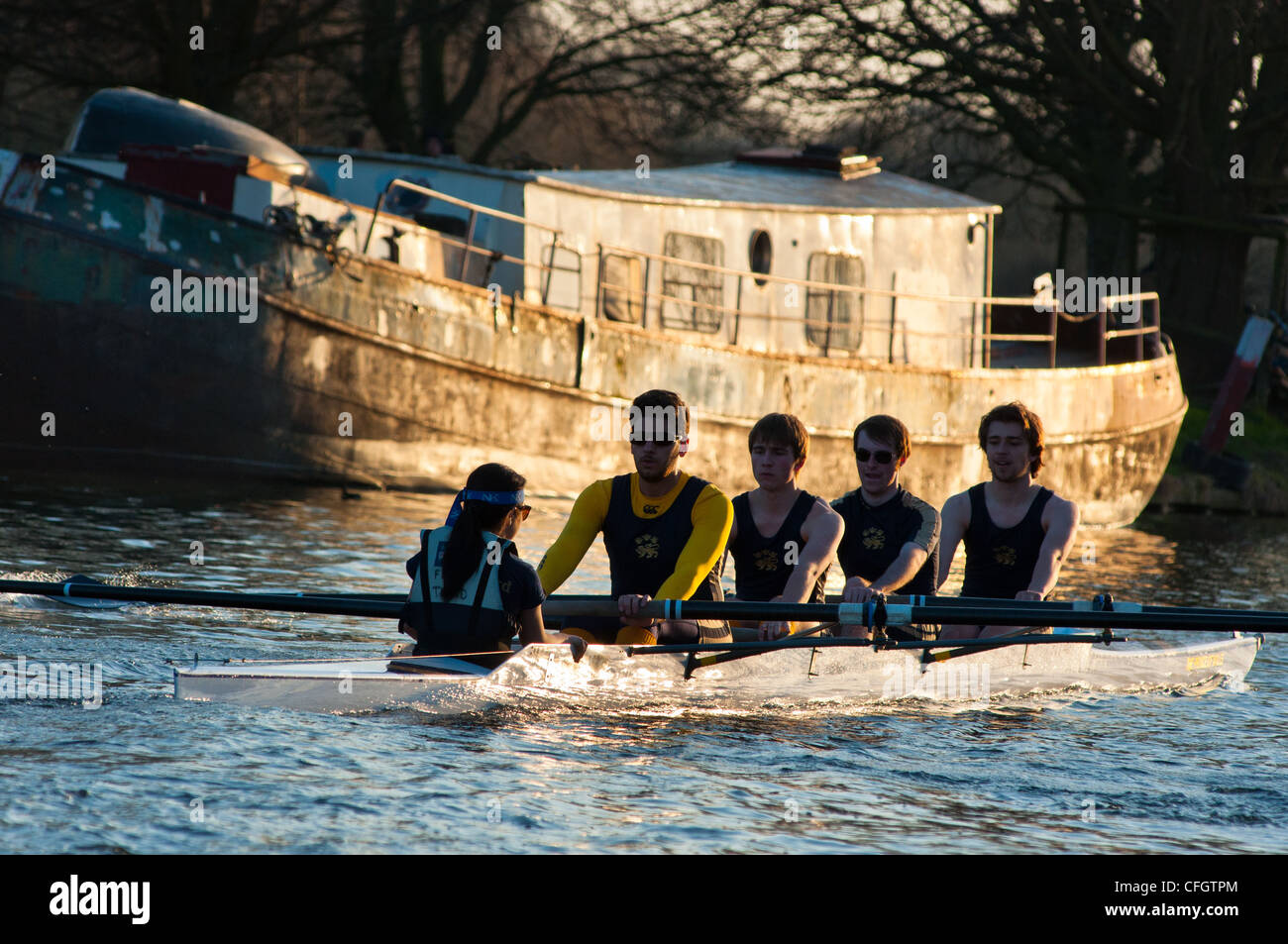 Rowers at sunset on river Cam near Cambridge, England. - Stock Image