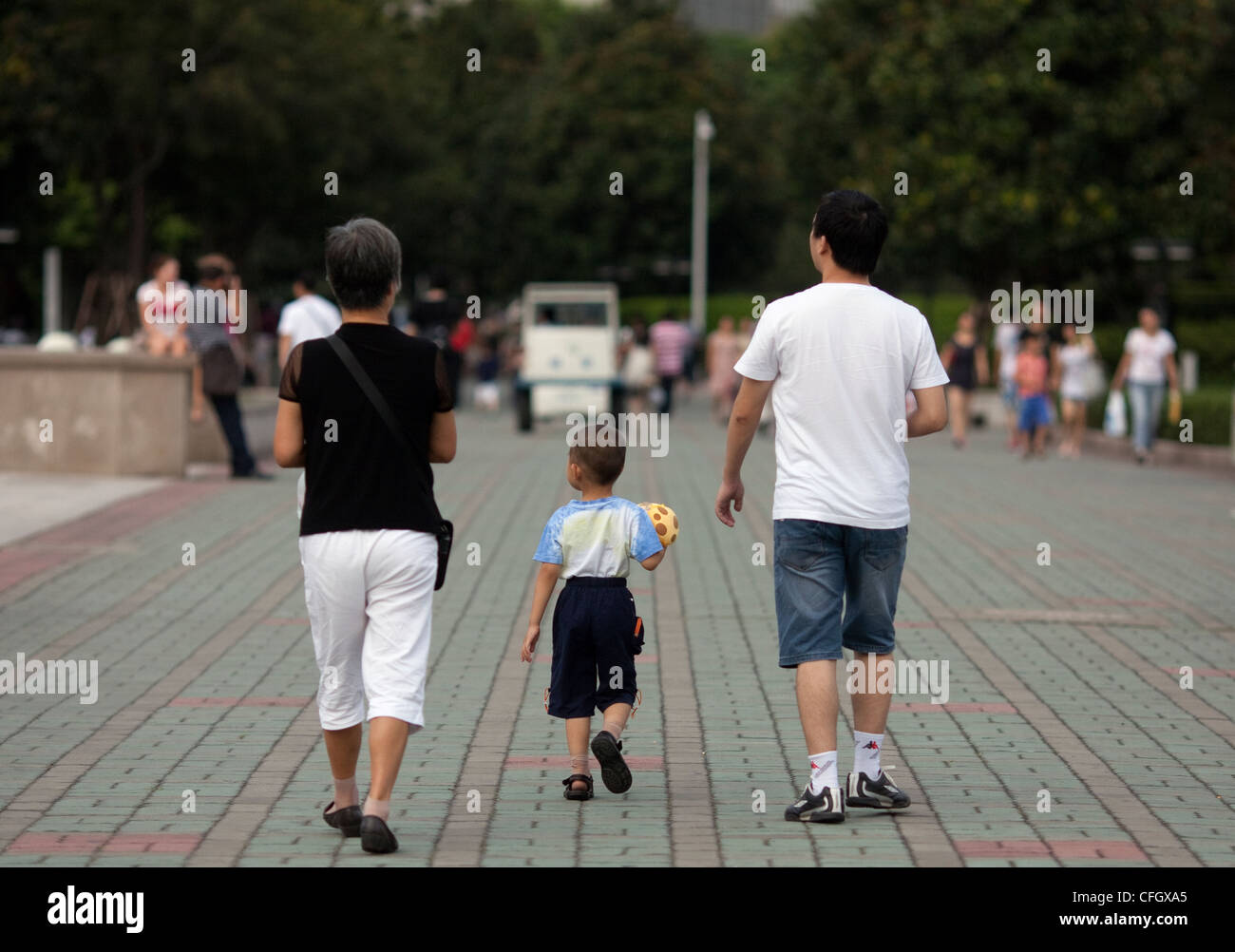 A one child family at the park in China, Shanghai - Stock Image