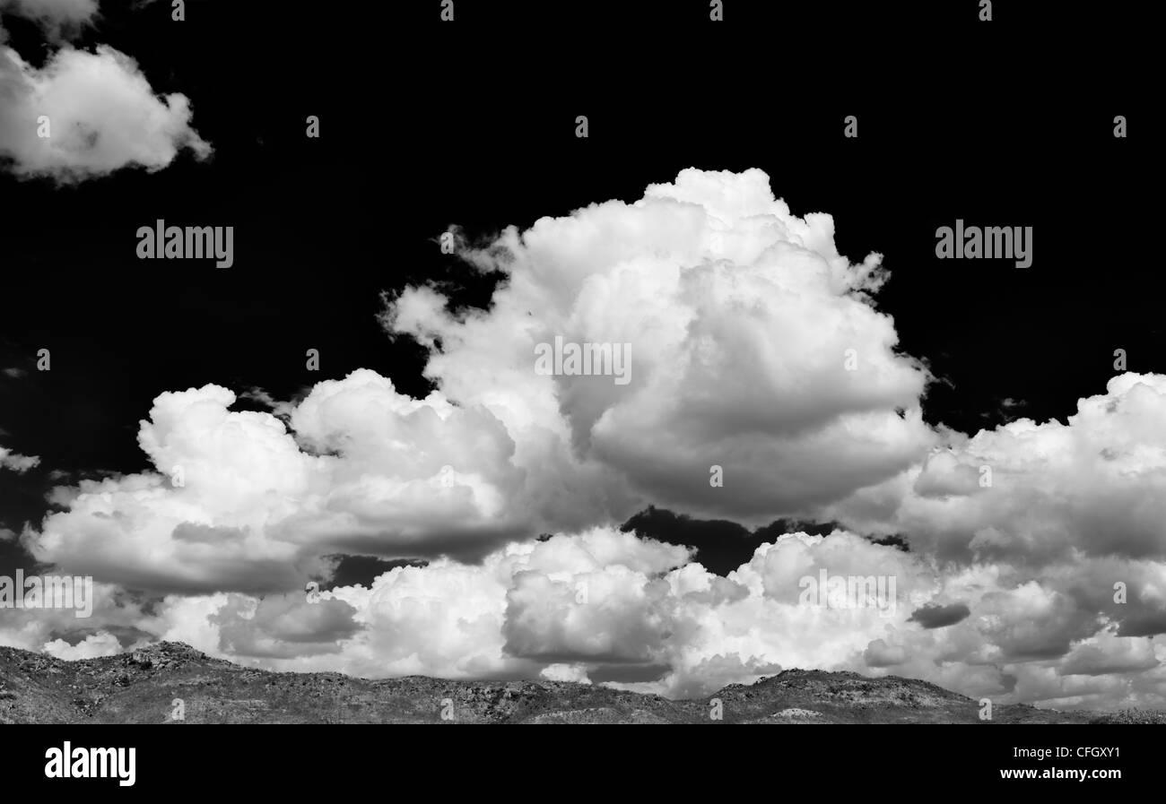 Altocumulus undulatus and cumulus clouds. Cloud sky panoramic. India. Monochrome - Stock Image