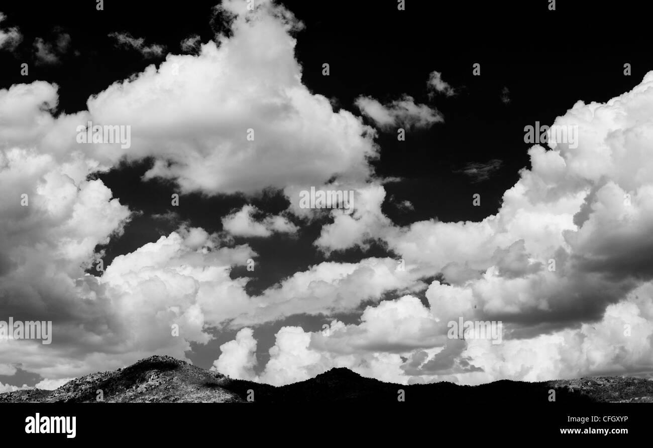 Altocumulus undulatus and cumulus clouds. Cloud sky panoramic. India. Monochrome Stock Photo