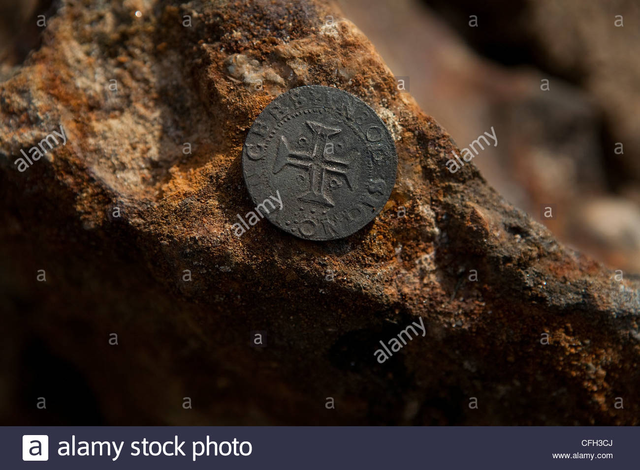 A silver coin excavated at the shipwreck site of a Portuguese trading vessel. - Stock Image